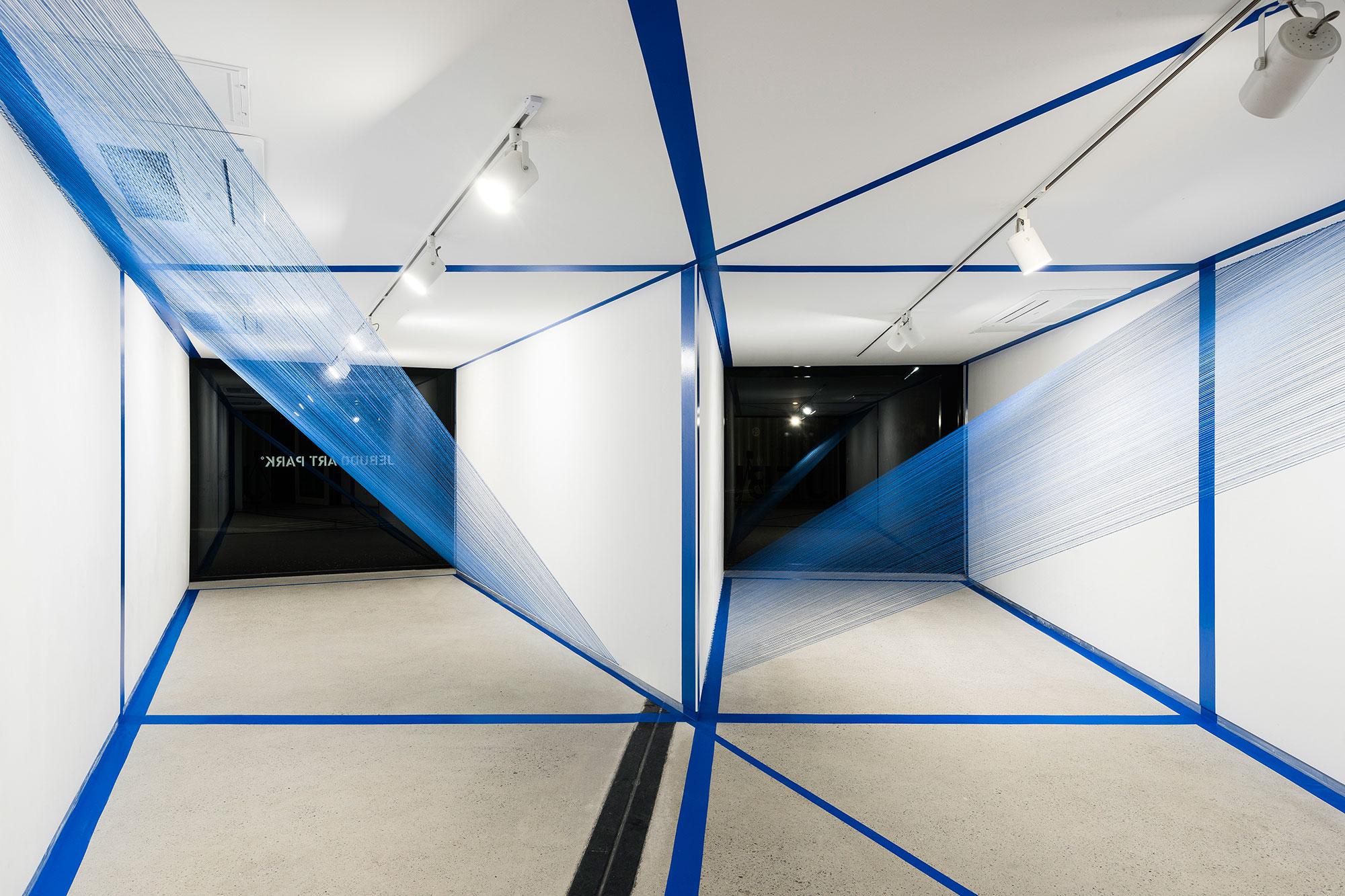 2.EunHyeKang_Gestalt_Tape,-Cotton-yarn_Site-specific-installation_2018.jpg