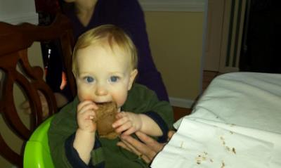 My son Reid, two-fisting his 1st Birthday cake like a champ.