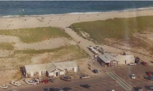 An overhead view of the beach around 1990. Liam's is to the right with tables and umbrellas between it and the beach (bostonglobe.com)