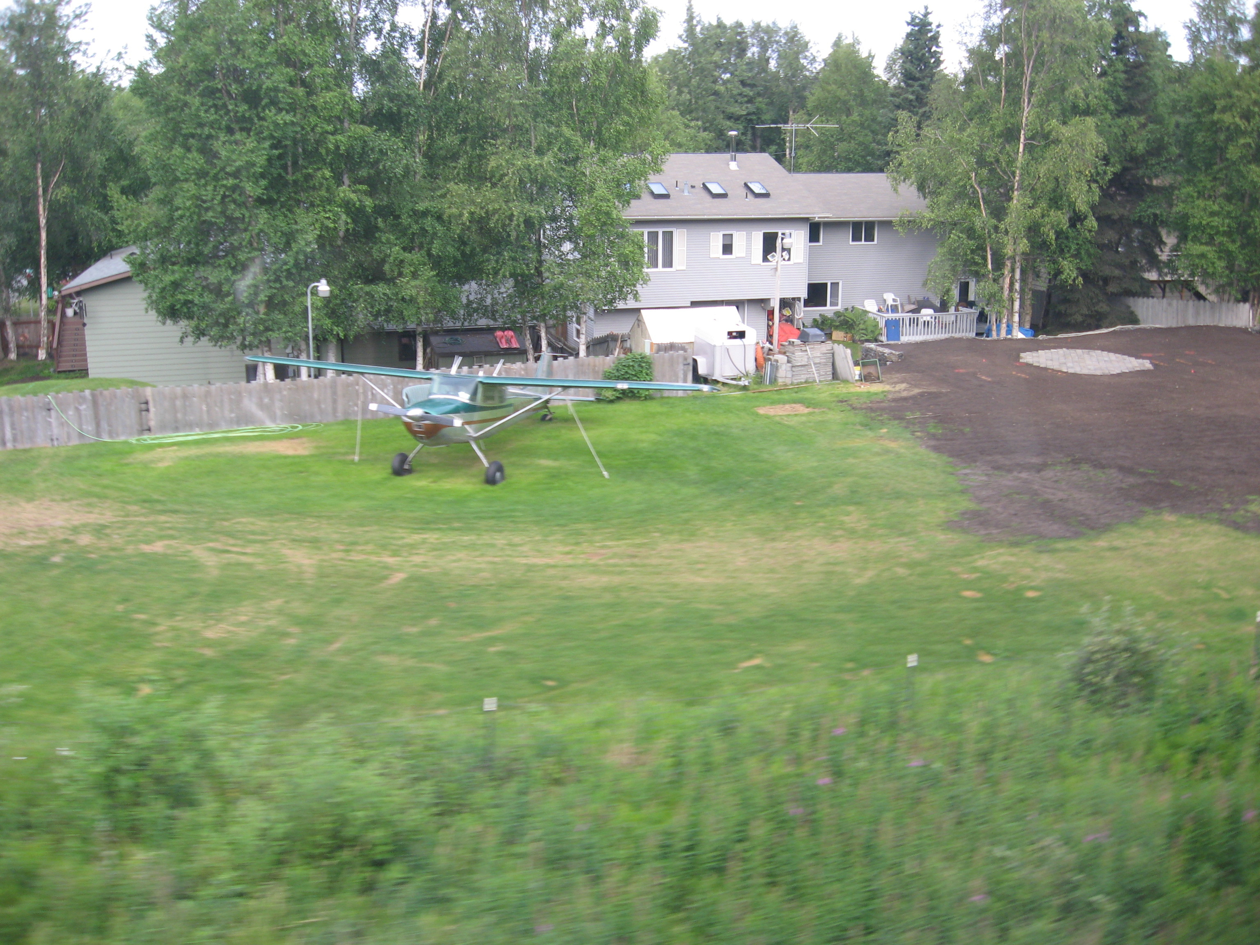 This photo was taken from the train on the way to rafting.  There is a community in the city limits that has a backyard airstrip...talk about fly-in fly-out!