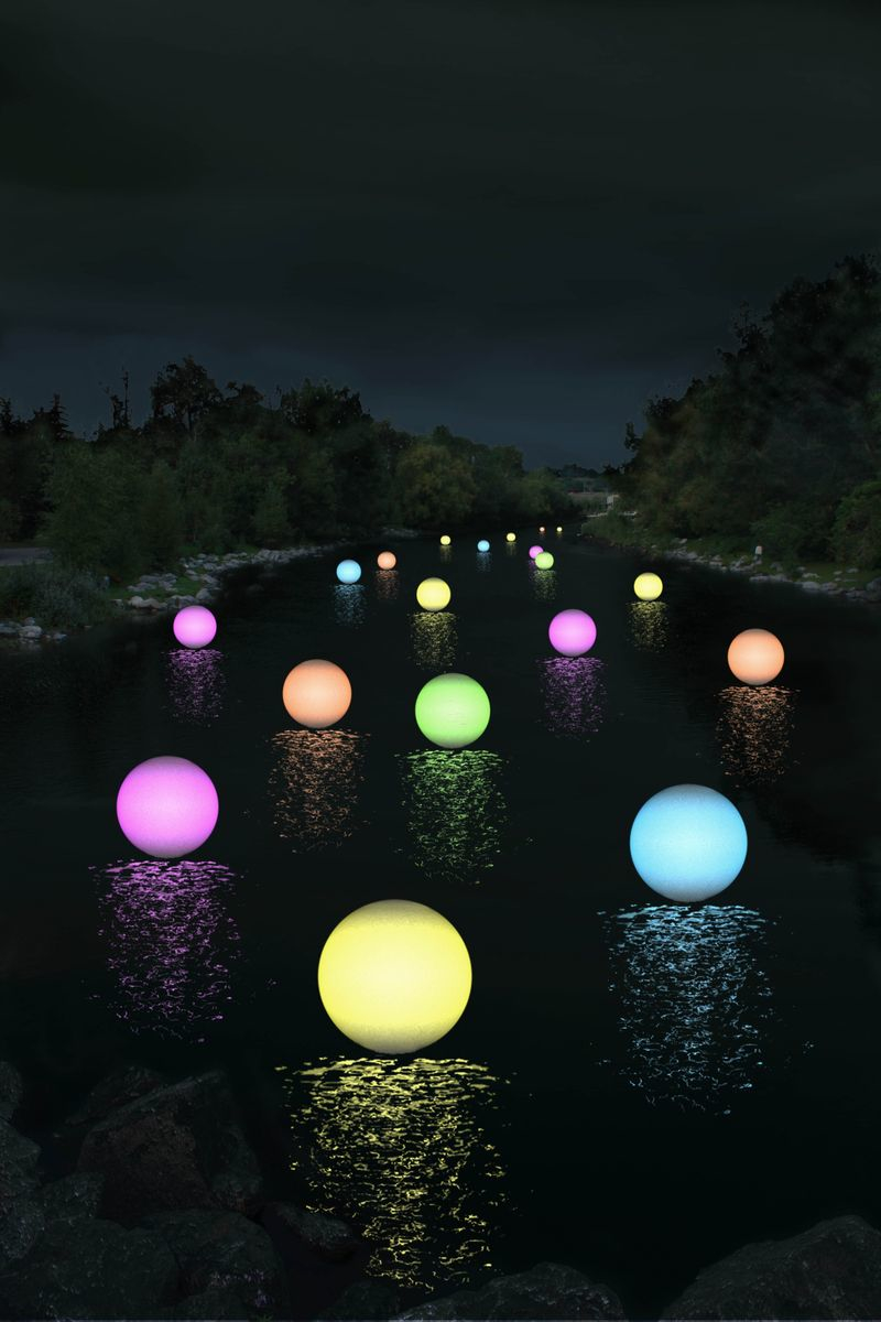 iver of Light project in 2010, attracted over 10,000 people to watch 500 orbs float down the river.  It was magical!