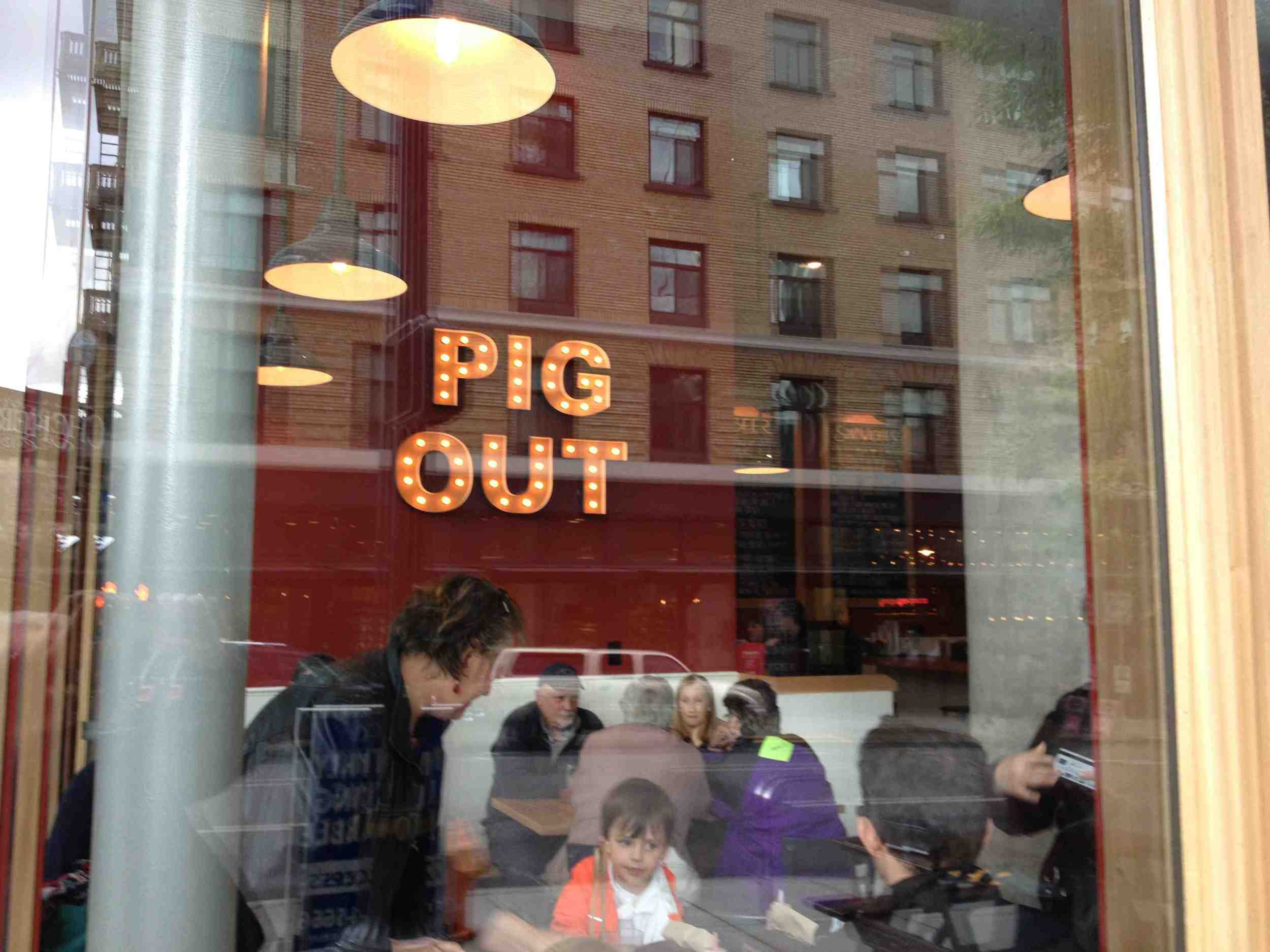 Portland is know for its street food i.e. food carts that are clustered into pods on empty lots throughout the city and in downtown parking lots. In this case the food cart has become a bricks and mortar restaurant. The name is not Pig Out, but that is the brand.
