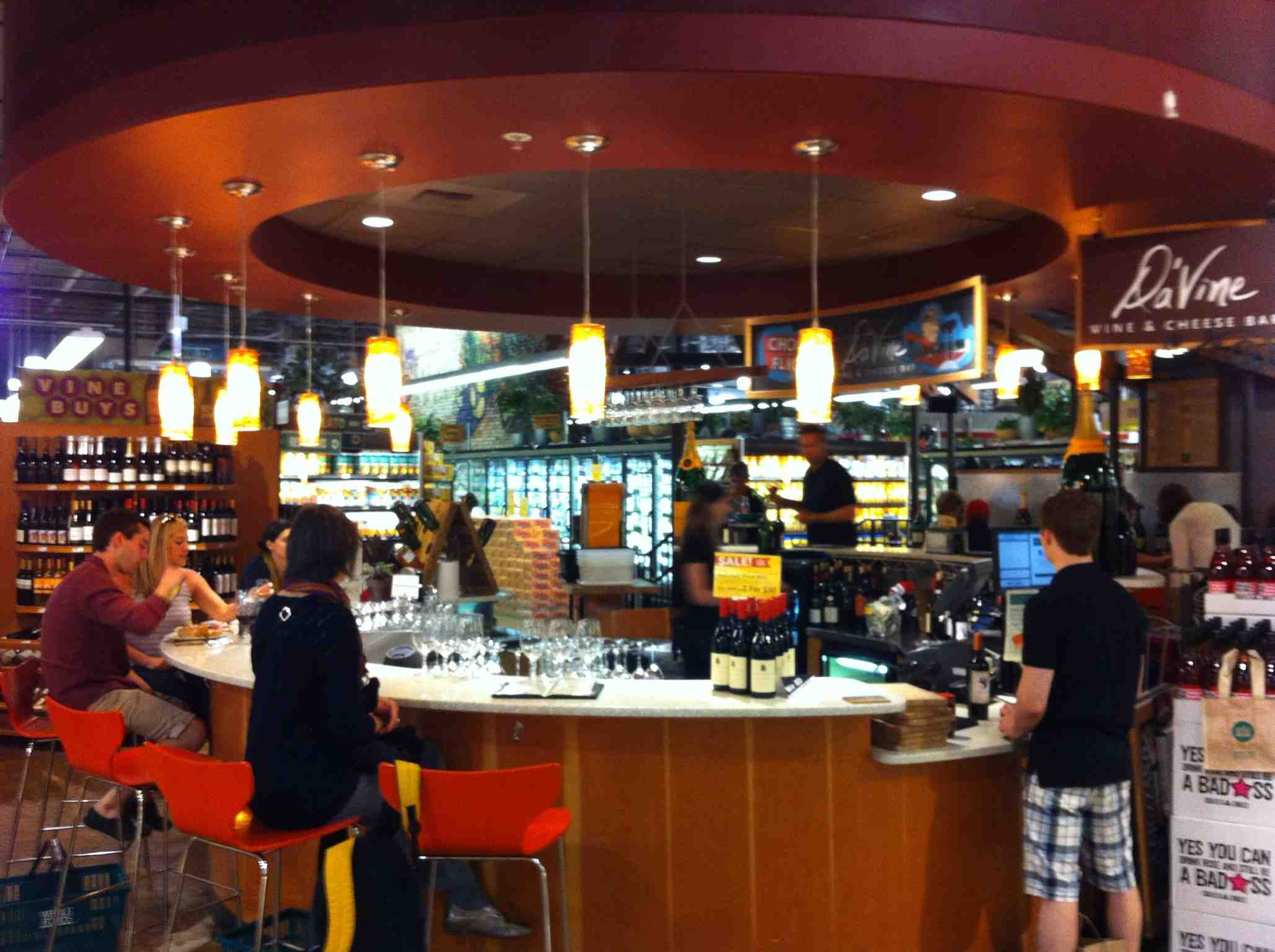 The wine bar at Whole Foods store Lincoln Park, Chicago.  There was a nice ambience, even though it was in the middle of a grocery store.  There was great people watching not only at the bar but in the yogurt section as one lady had to climb up on the coolers to check out product at the top, almost falling in as she did so.