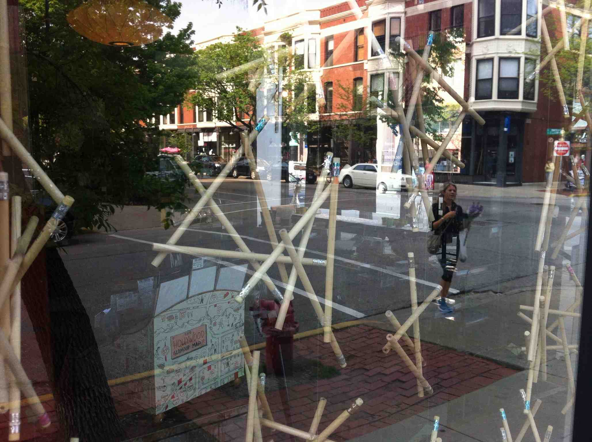 This is a stationary store window in Old Town.  I loved the  fun use of the pencils.  It was only later that I realize that reflection of the one-legged women really dominates the photograph and gives it an another level of fun/surprise which is what window licking is all about. Great streets are full of surprises.