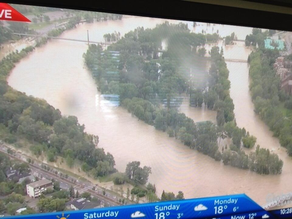 Aerial image of Prince's Island, Calgary's summer playground totally flooded.  In many ways this is the heart of the city.