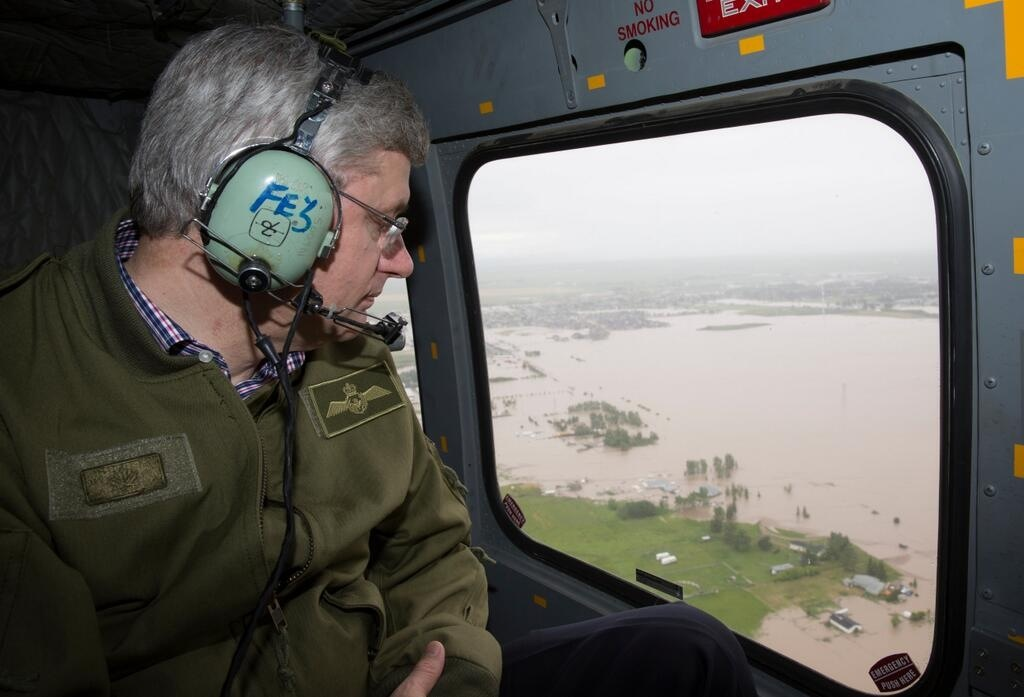 Prime Minister Stephen Harper surveying the damage.  Our politicians were amazing in their leadership as they were calm and articulate in the face of disaster.  Our emergency officers and city staff were tireless in their efforts.  The emergency response plan was outstanding.