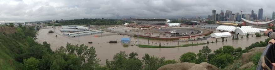 Panoramic view of Stampede Park totally flooded.  Normally the Elbow River is just a quiet river at the based of the bluff maybe 15 meters wide at most.