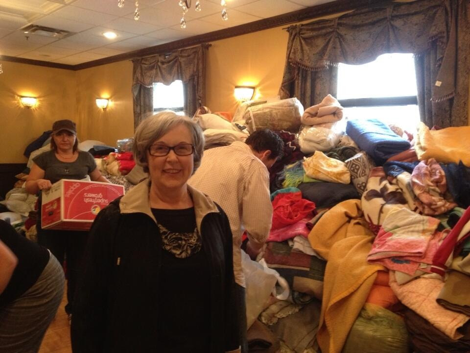 Alderman Gael MacLeod with volunteers sorting out clothes for those who were evacuated which included homeless shelters and affordable housing for seniors.  As soon as a state of emergency was called Calgarians were asking how can they help.  Calgary has a longstanding culture of caring and volunteering.