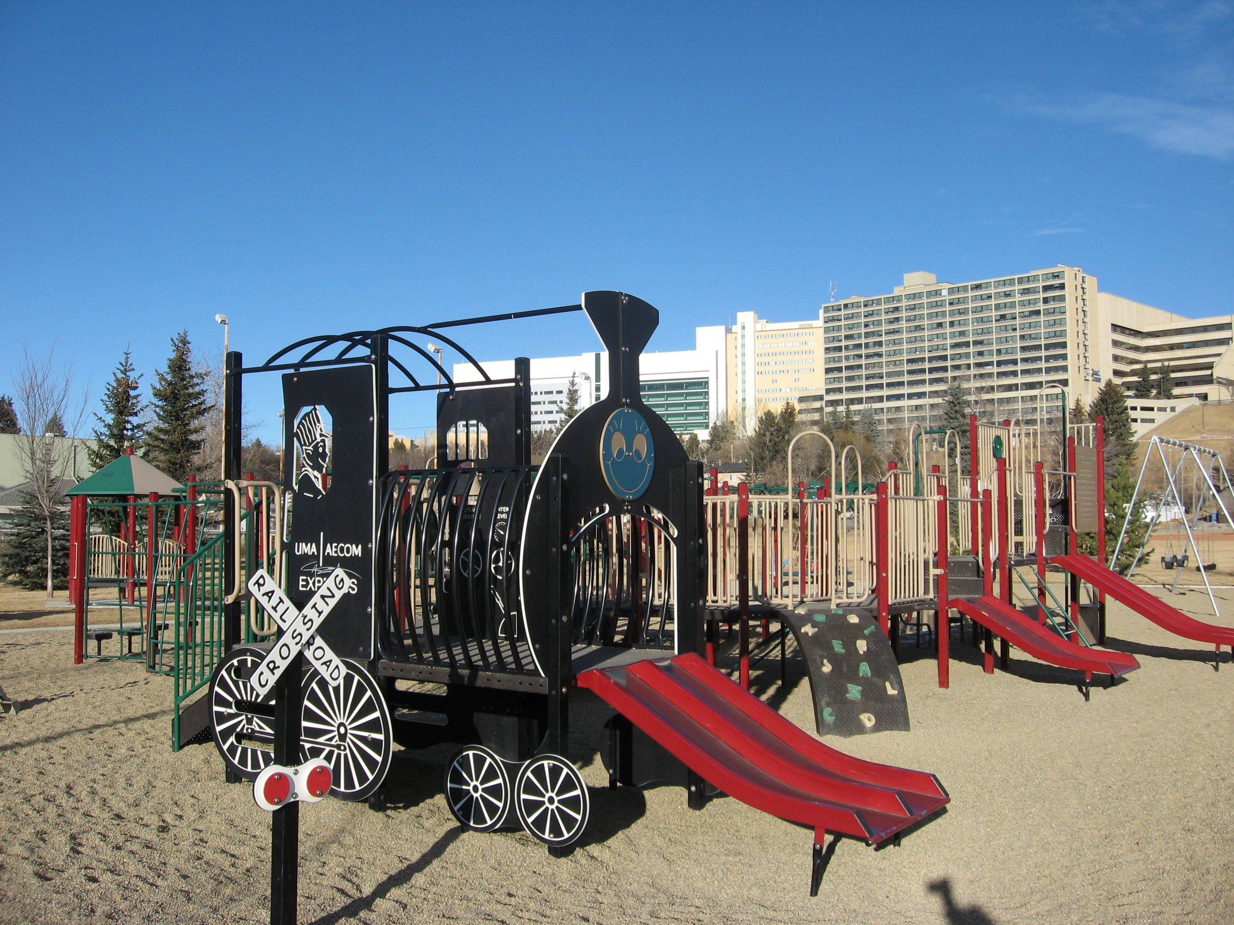 One of the many upgraded playgrounds in Calgary's City Centre.  No home is more than a few blocks from a playground.