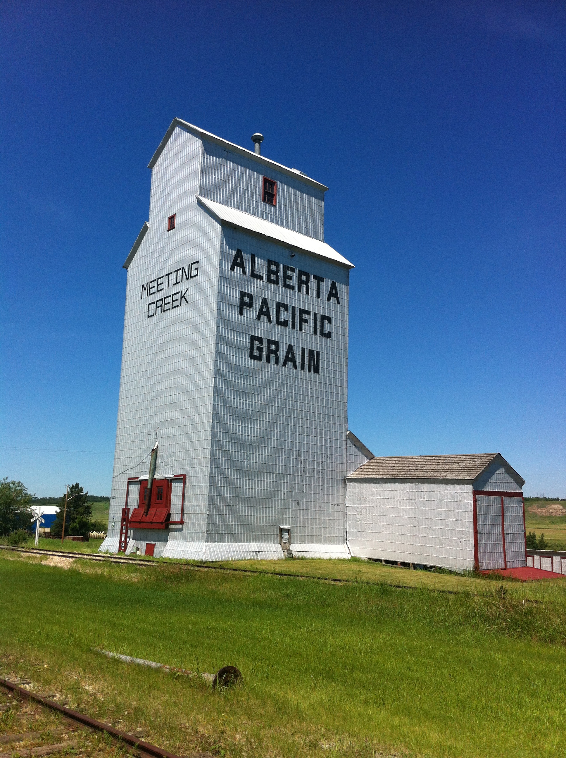 This 40,000 bushel elevator was constructed by the Alberta Pacific Grain Company in 1917 or 1918 depending on what didactic panel you believe. It was subsequently acquired by the Alberta Wheat Pool and operated until 1984.  In 1989, it when it was donated to the Canadian Northern Railway Society.  It has been refurbished and opened for public display.