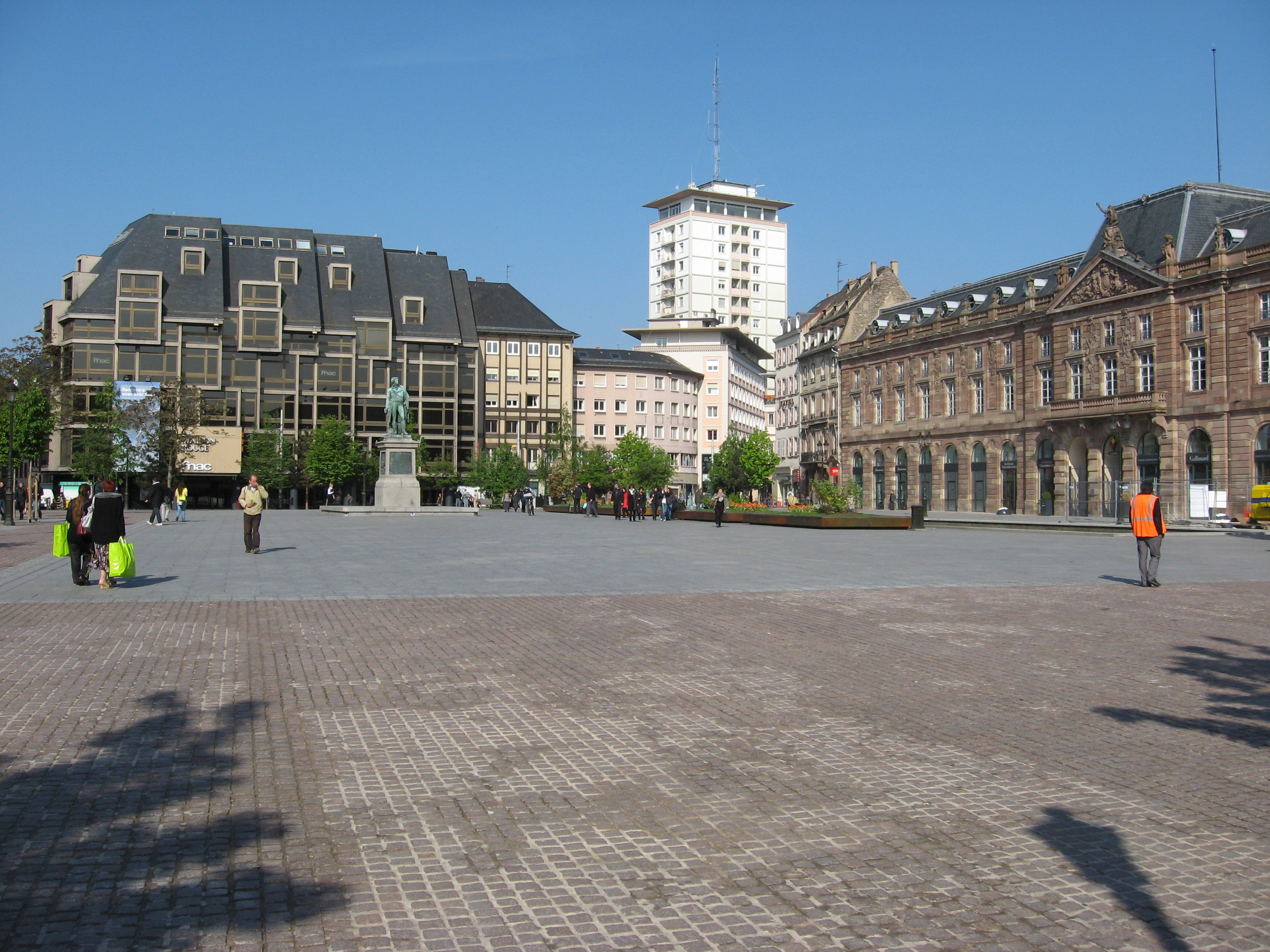Strasborg town square is a wide open flat hard surfaced space that can be used for a variety of activities.  This is an early morning photo, later in the day it is busy with people cutting through or on market day it is full of vendors.