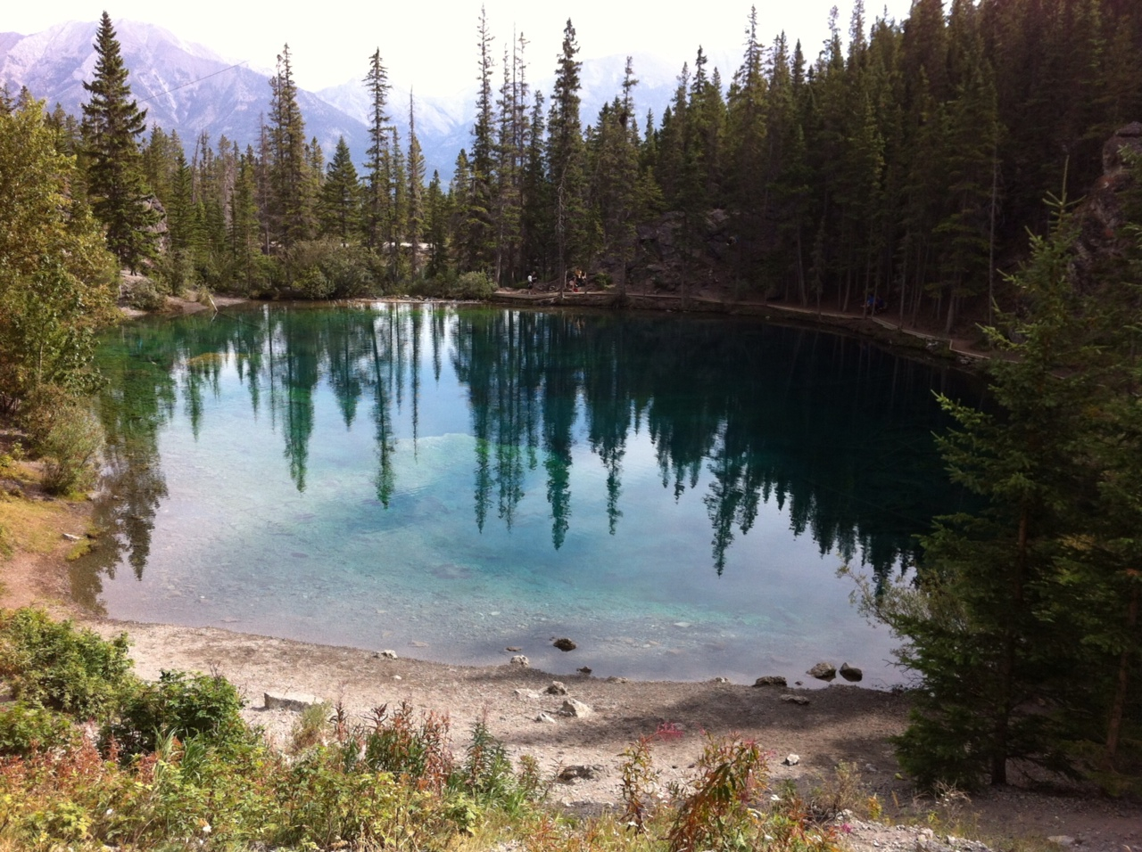 A postcard view of the upper Grassi Lake with its crystal clear aquamarine colour water.  Yes it looks surreal.