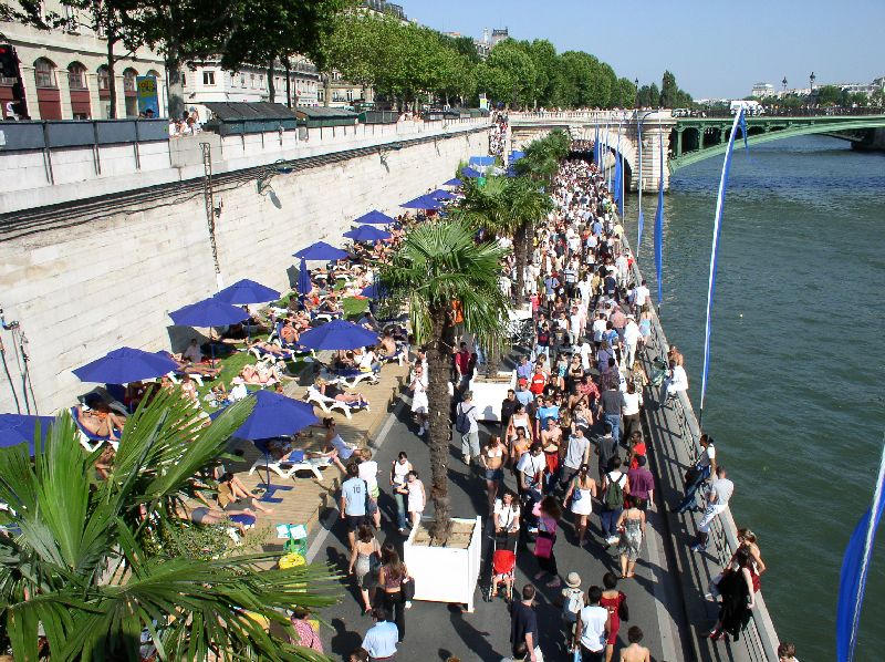 One of Paris' popular beaches.  Note it is beside the river not on the river's edge.  It is more like a huge patio.