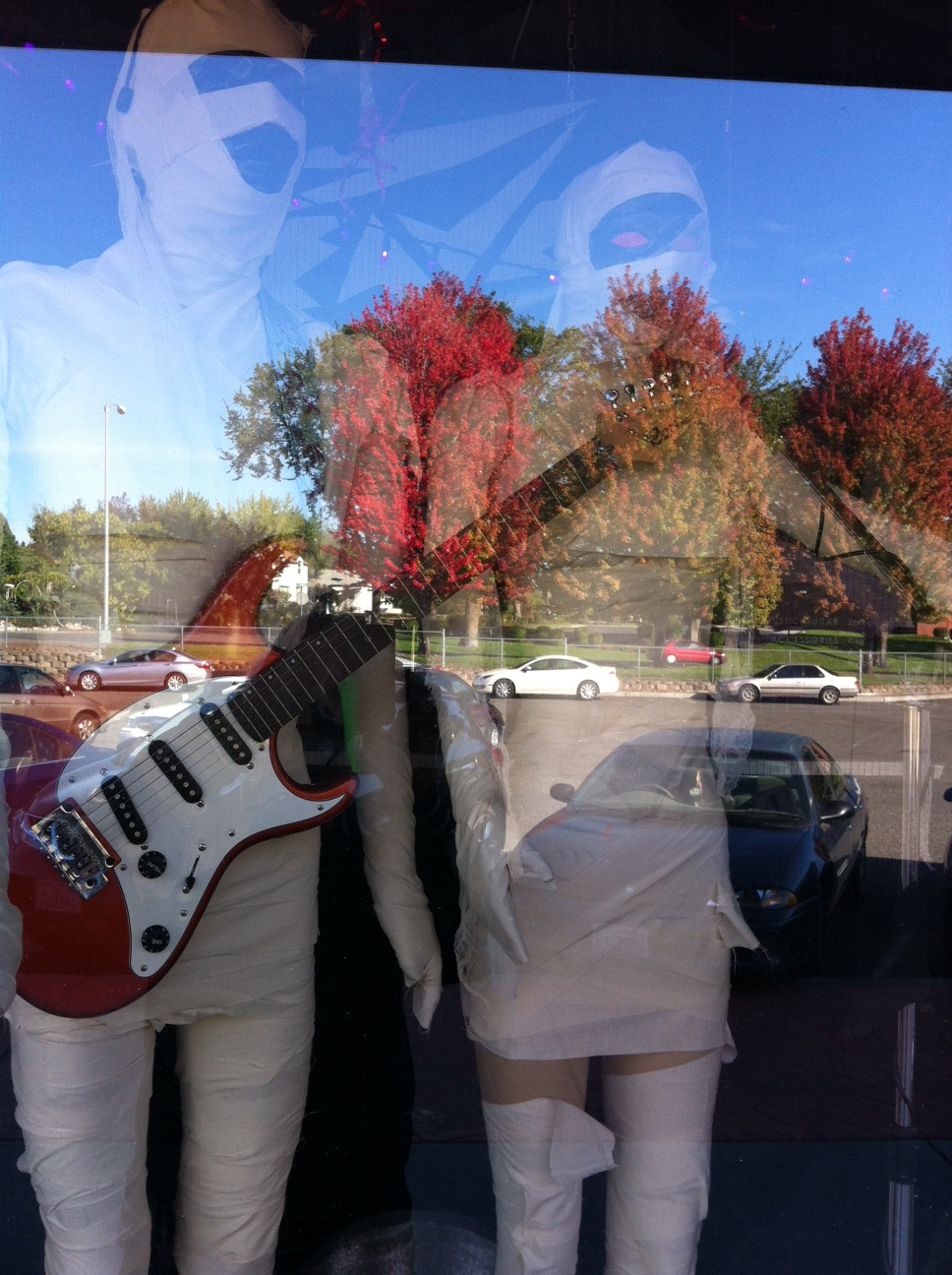 "One of the things we love to do when flaneuring is ""window licking"" i.e. window shopping (the french word literally translates into window licking).  One of the things like love is the reflections in the windows and the juxtaposition of the images.  They create rich collages of images that have their own wonderful narrative. Like this one in the music store."