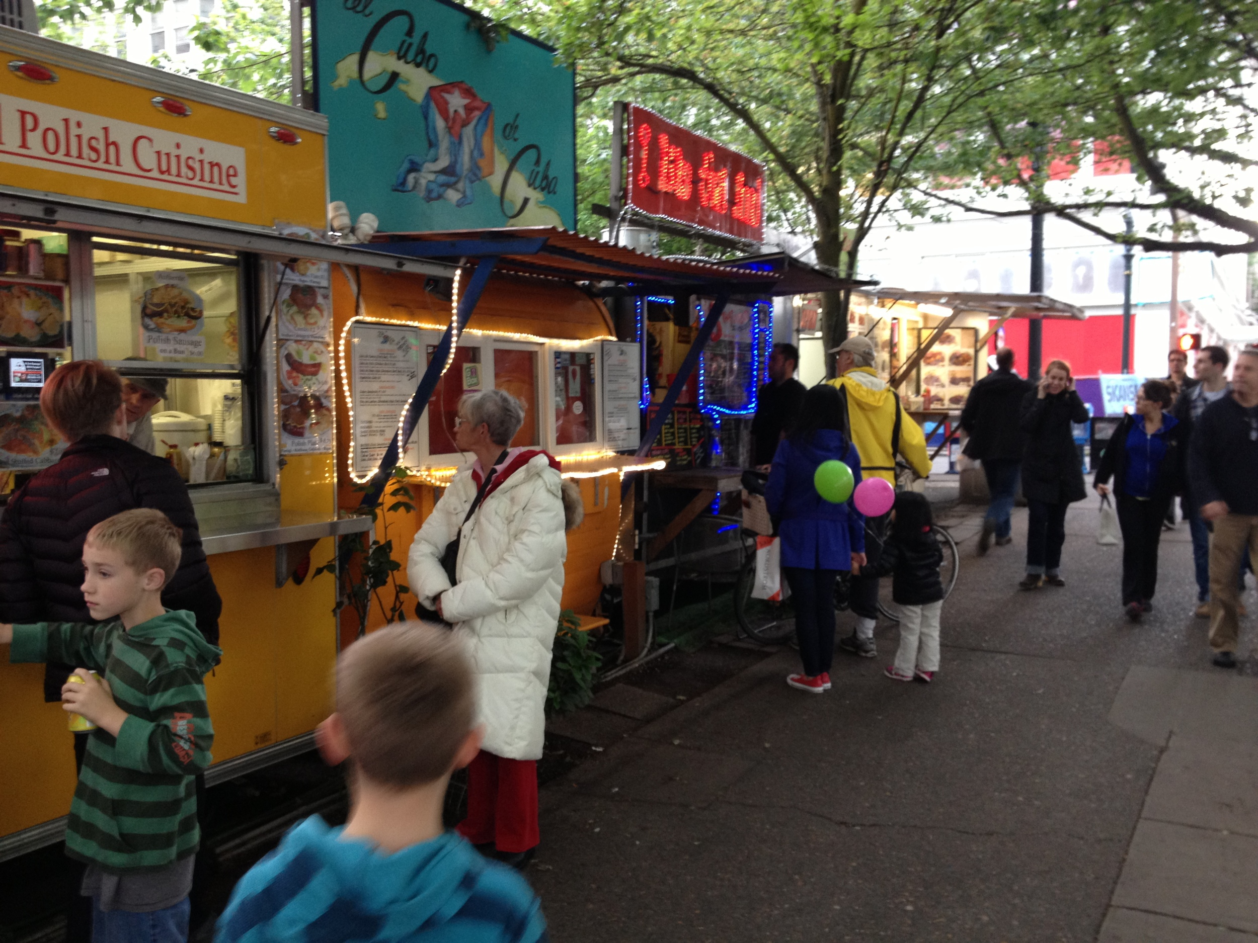 While not all of the streets of Portland are lined with food carts there are lots of them around.  Technically they are not food trucks as they don't move from location to location, they are set up permanently in parking lots throughout the city centre.