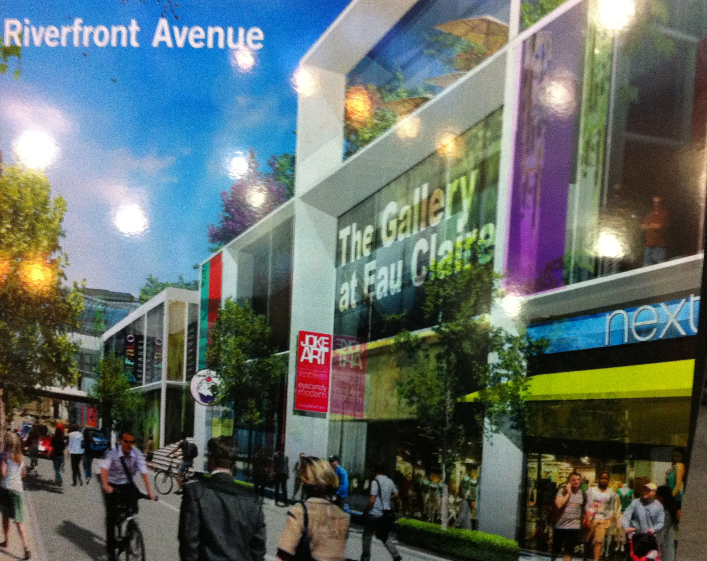 "Plans call for Riverfront Avenue to become a pedestrian street with shops facing onto the street for a more traditional urban ""high street"" experience."