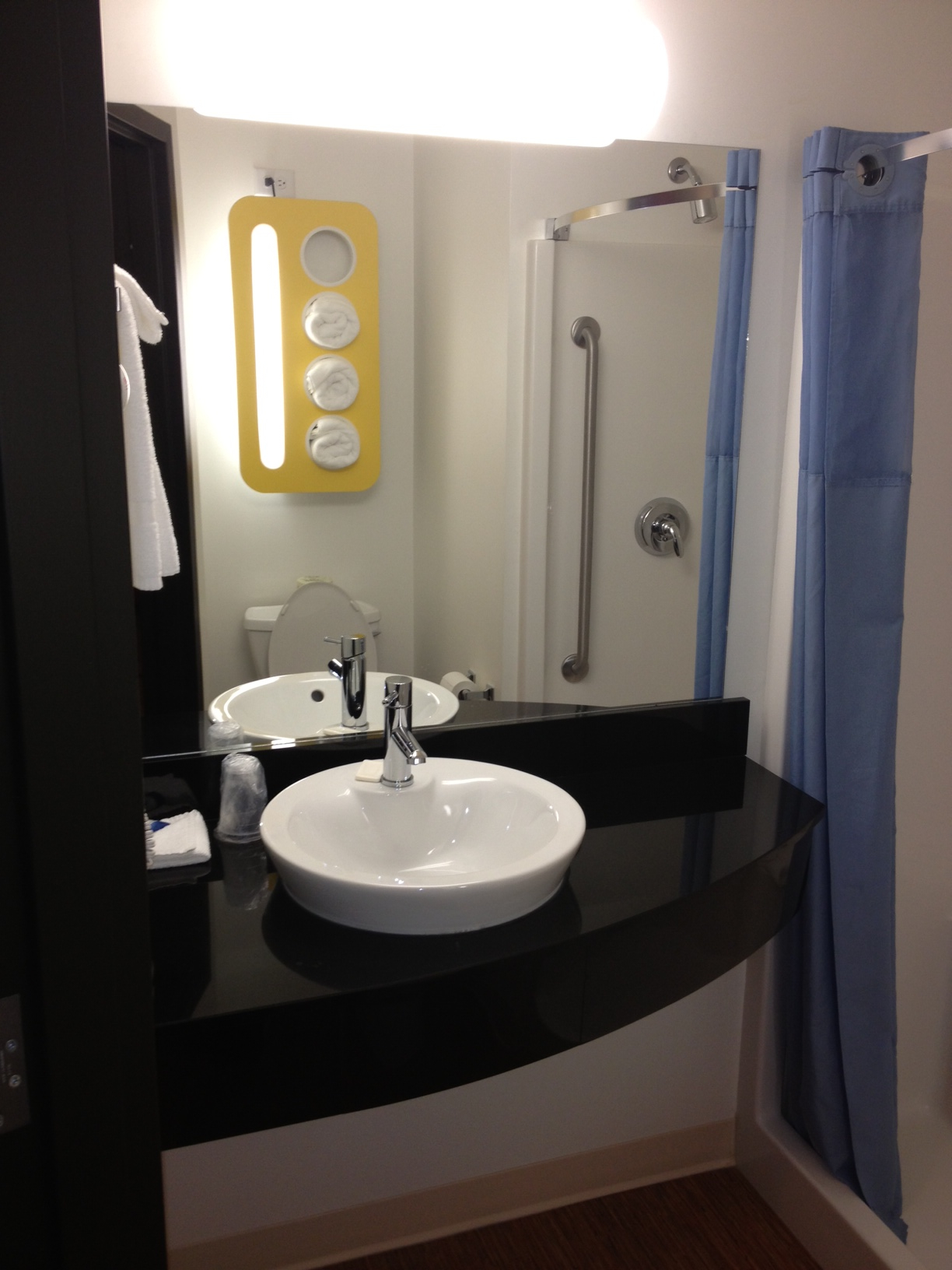 The bathroom was also very contemporary with the yellow towel holder/warmer/light reflected in the mirror.