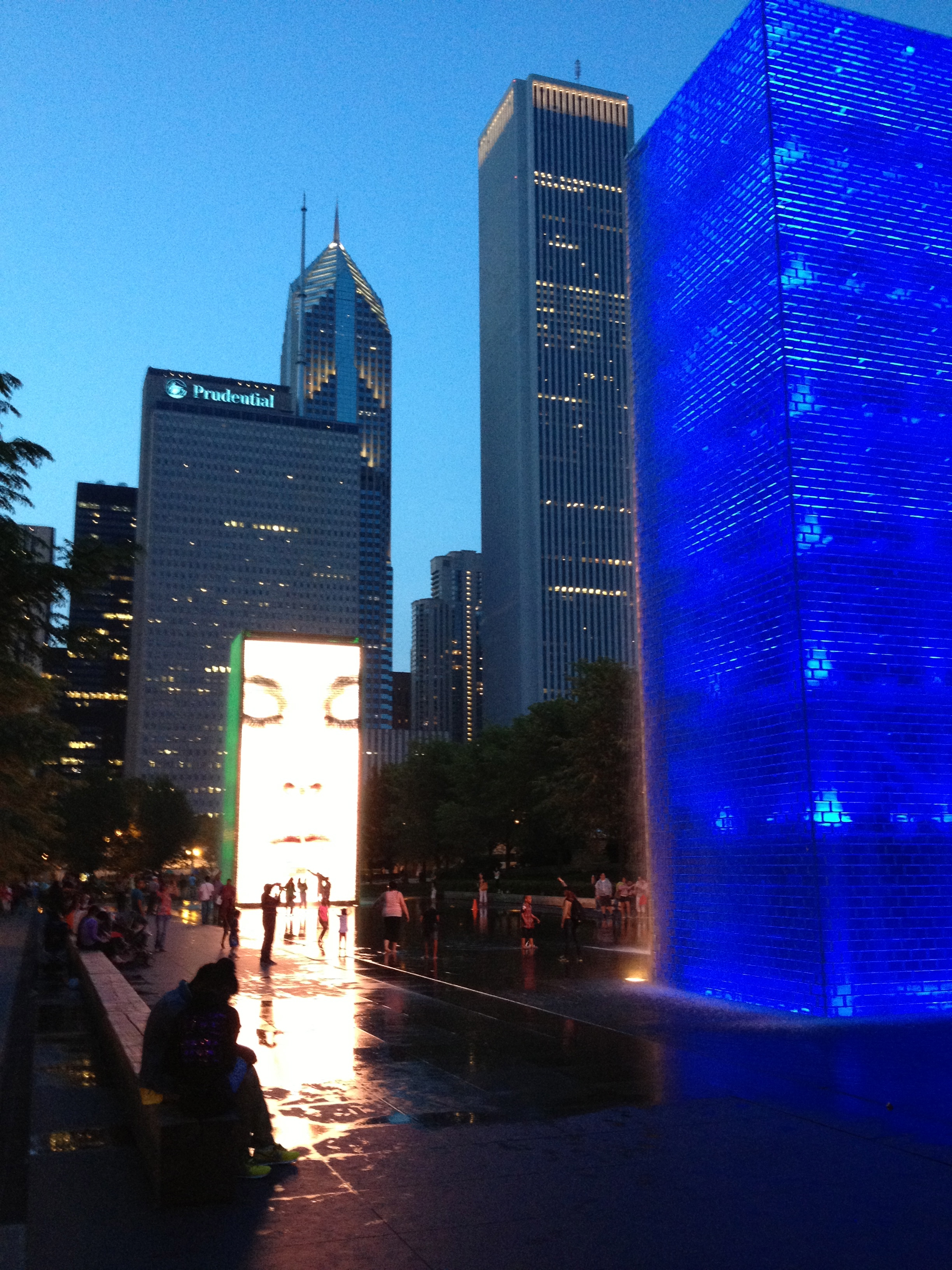 Even at night the Crown Fountain attracts hundreds of people of all ages and backgrounds to play and interact with the LED faces and the wading pool.