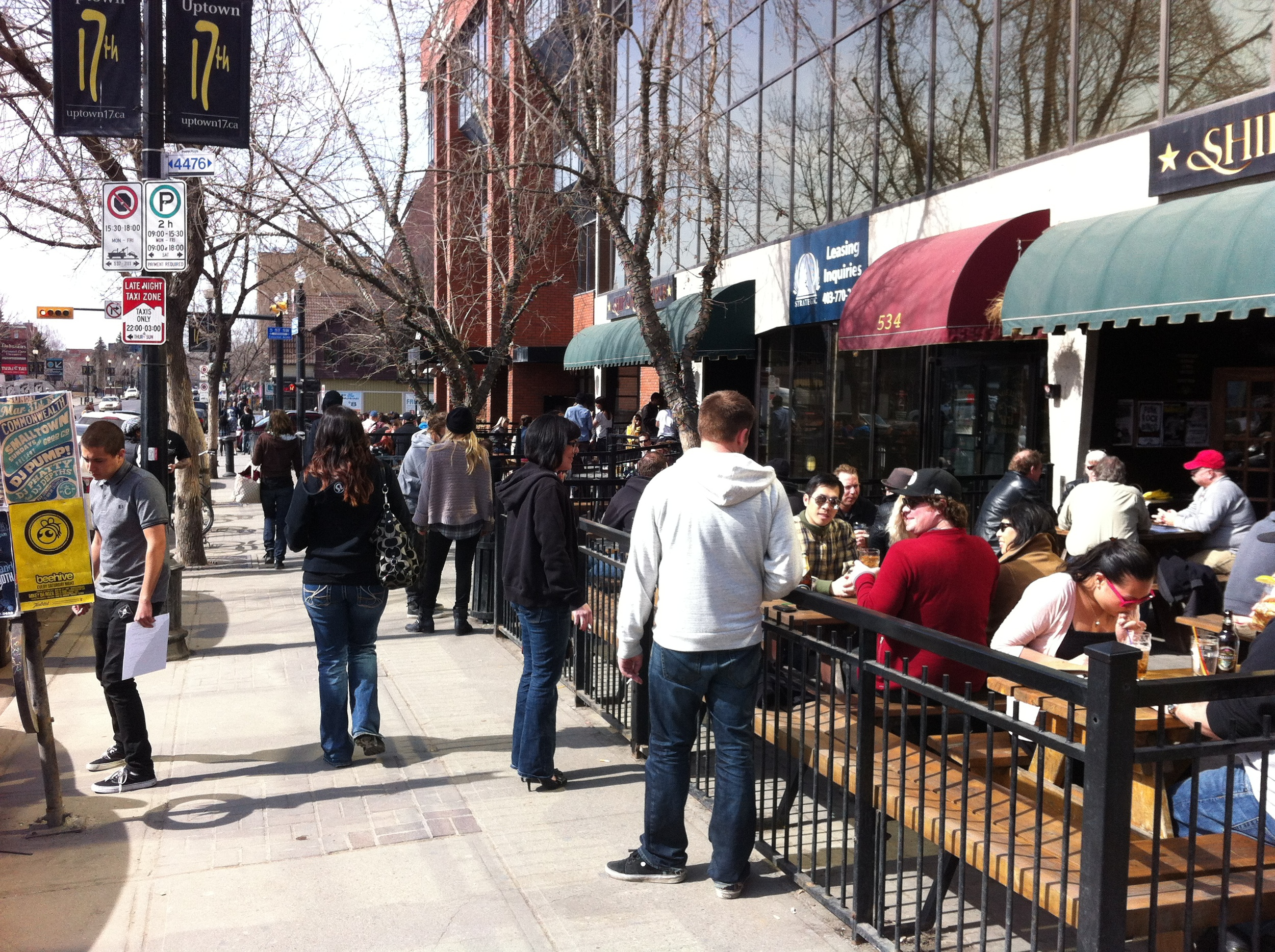 The Ship & Anchor patio and 17th avenue are full of people in March 2013.