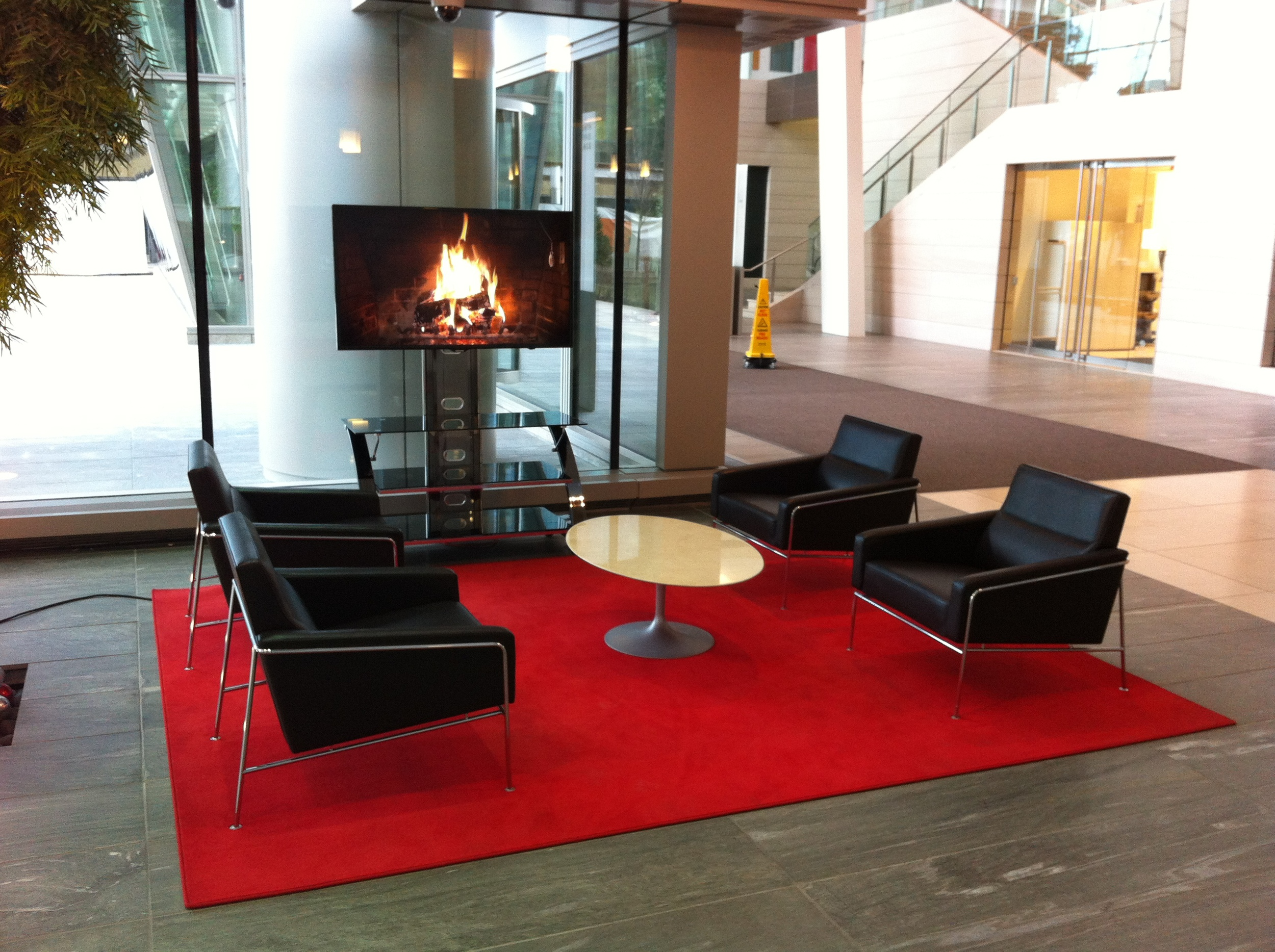 The lobby has several inviting areas to sit and linger each authentic modern furniture.  And yes over the holidays they had the TVs turned to the Shaw's burning fireplace.