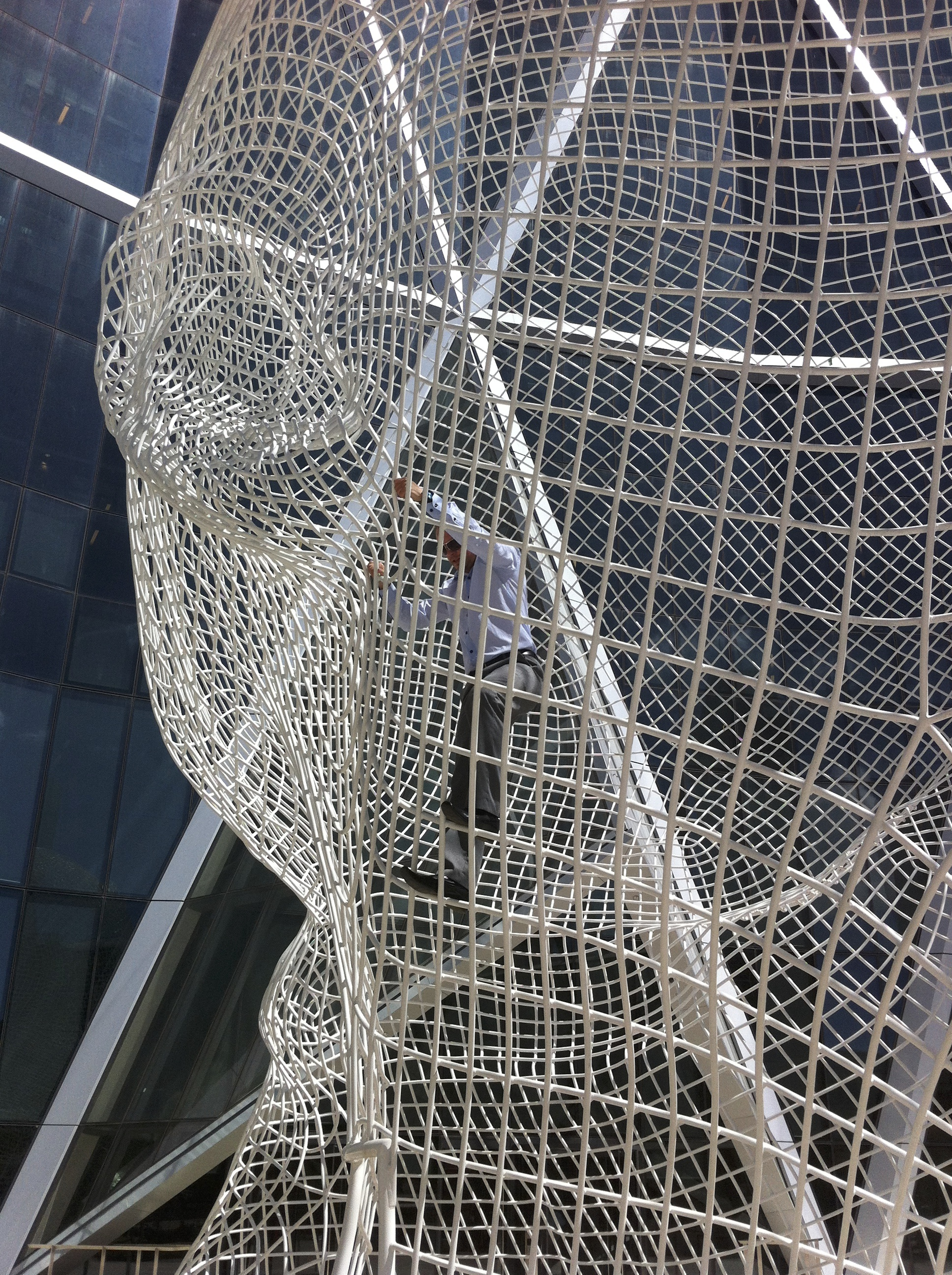 "GABEster climbing Plensa's ""Wonderland"" scultpture at lunch...public art as urban playground for adults?"