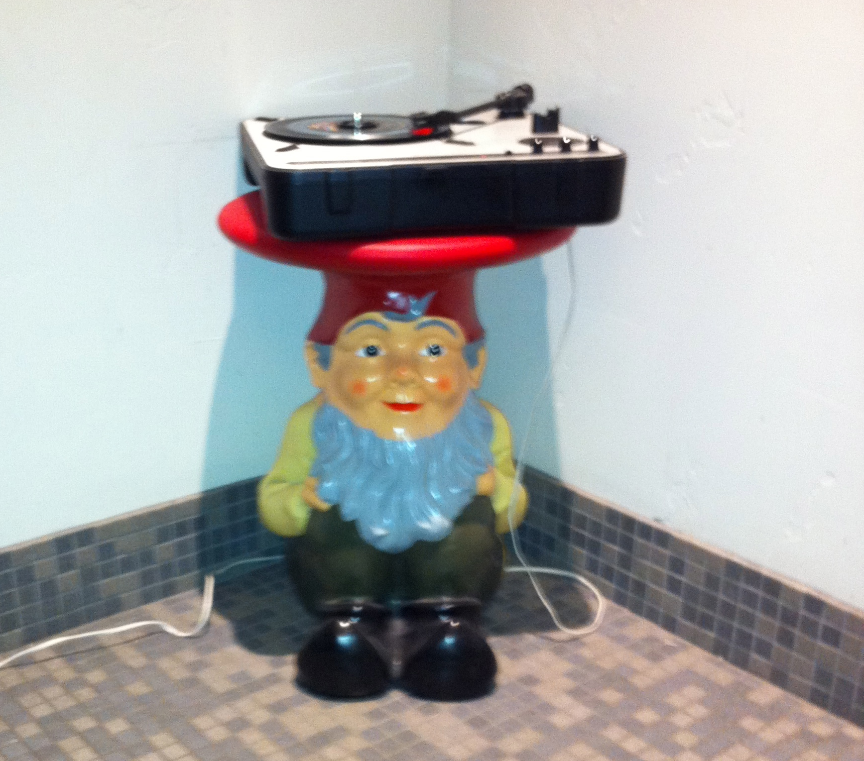 The gnome and record player in the Men's washroom (I am told there is a similar one in the women's) allows you to choose what music you want while you do your business. How cool is that? Keep Boise bad!