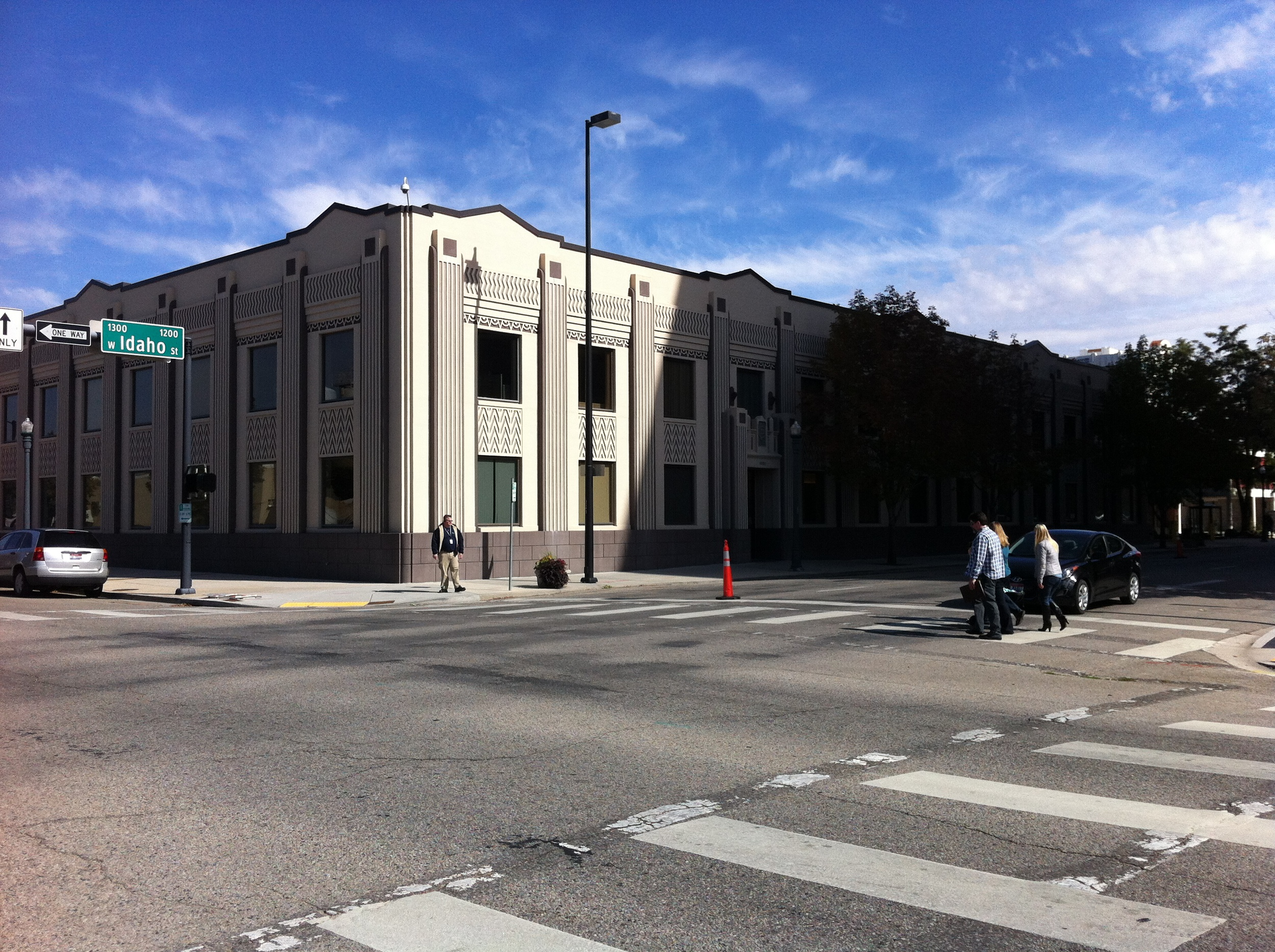 """Idaho Power Company's building at 1220 West Idaho Street. The is a good example of zig-zag Art Deco style with its forms repeating the American Indian symbol for lightning – a device also exploited in the """"Ready Kilowatt"""" character, long used to symbolize electrical companies.Designed by Wayland & Fennel in the mid-1930s, it has a later addition on the east end that mimics the original details."""