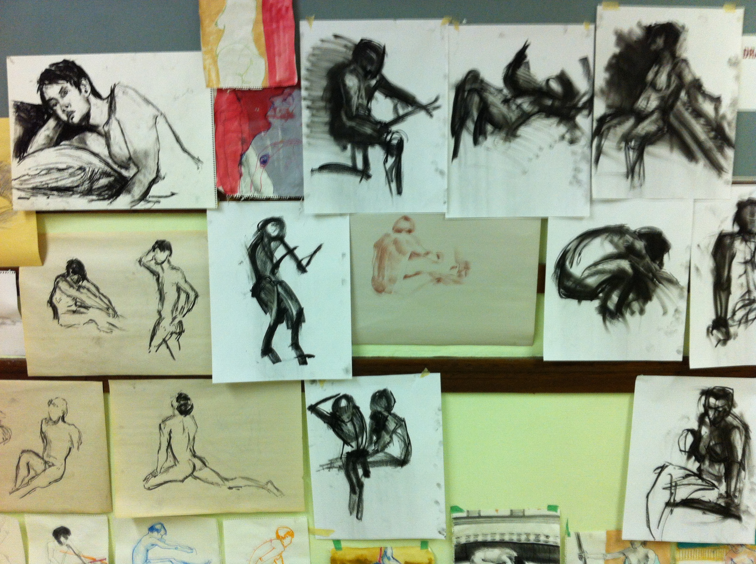 Figure drawing from floor to ceiling give the space a studio/school sense of place.