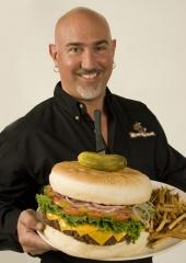 Shawn holding up the Kookamonga burger.