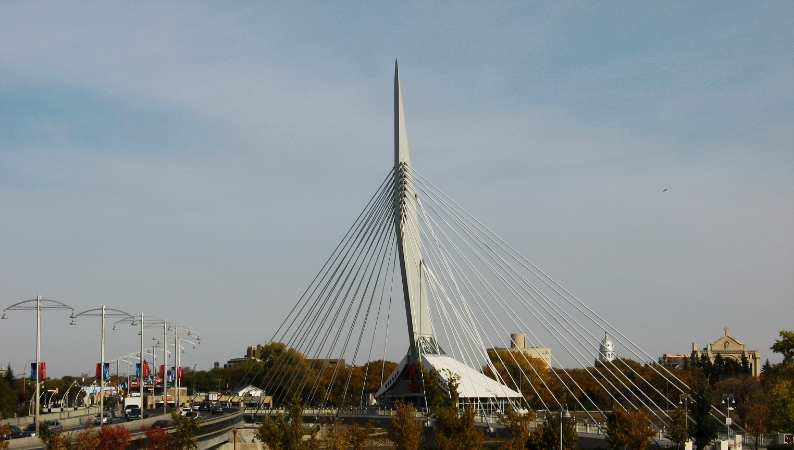 Esplanade Riel Pedestrian Bridge over the Red River in Winnipeg with restaurant in the middle.