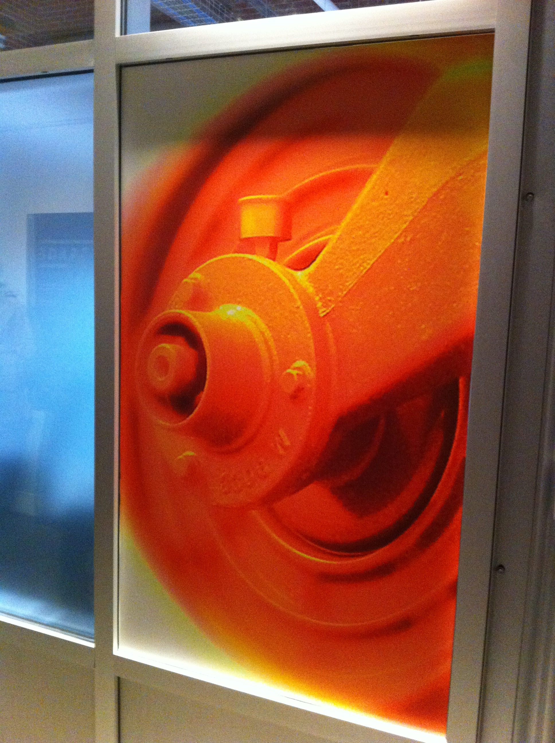 "At the back of the gallery were McCormick's colourful ""Fly Wheel Series"" digital art on vinyl."