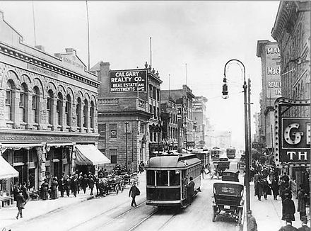 This is an early 20th century downtown Calgary street. Interesting to see how full the sidewalks are of people and how the road is shared by streetcars, cars and horse and buggies. I realize this was a slower time, but it does how how in the past we shared the road. Note how pedestrians had to walk into the middle of the street to get on the streetcar. Urban vitality and animation allows for integration not segregation.