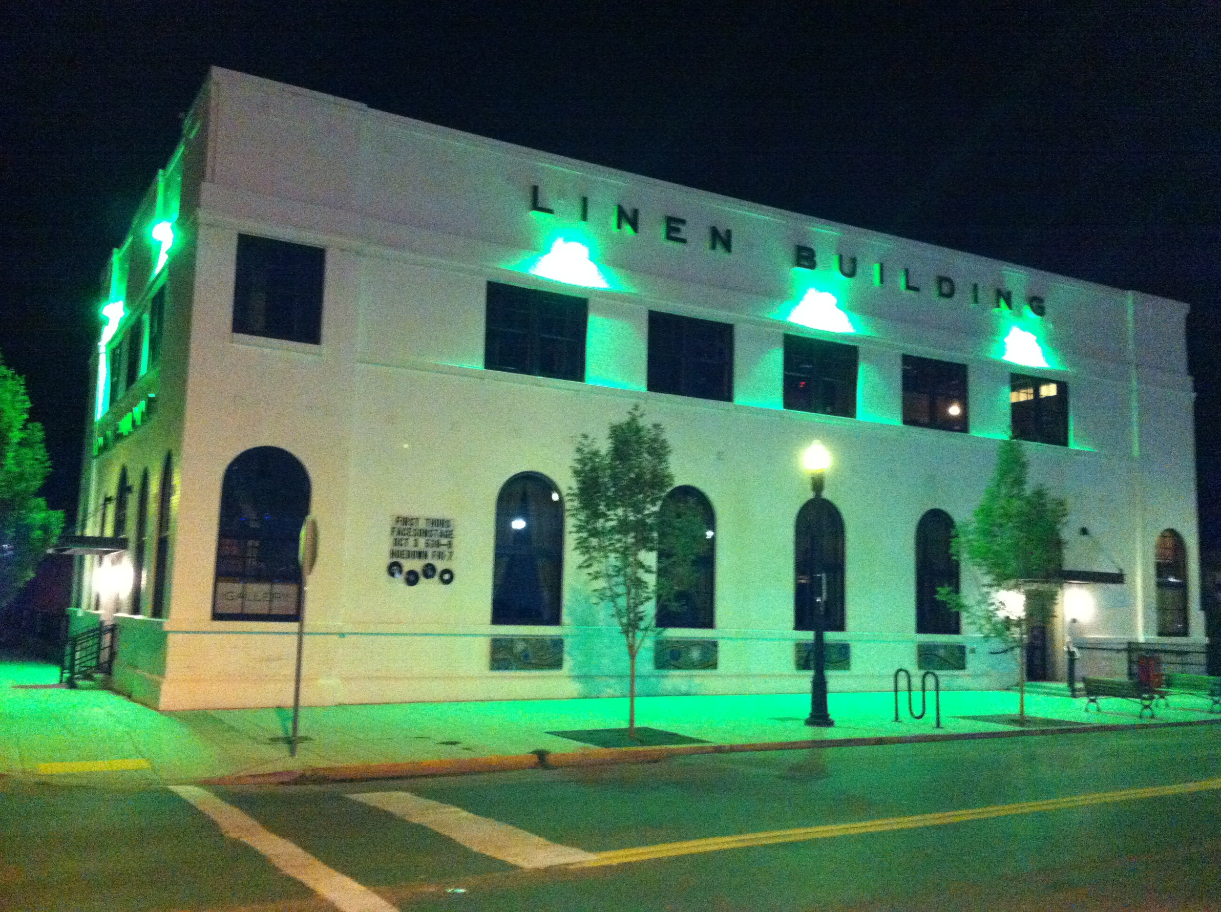 The historic Linen Building at night.