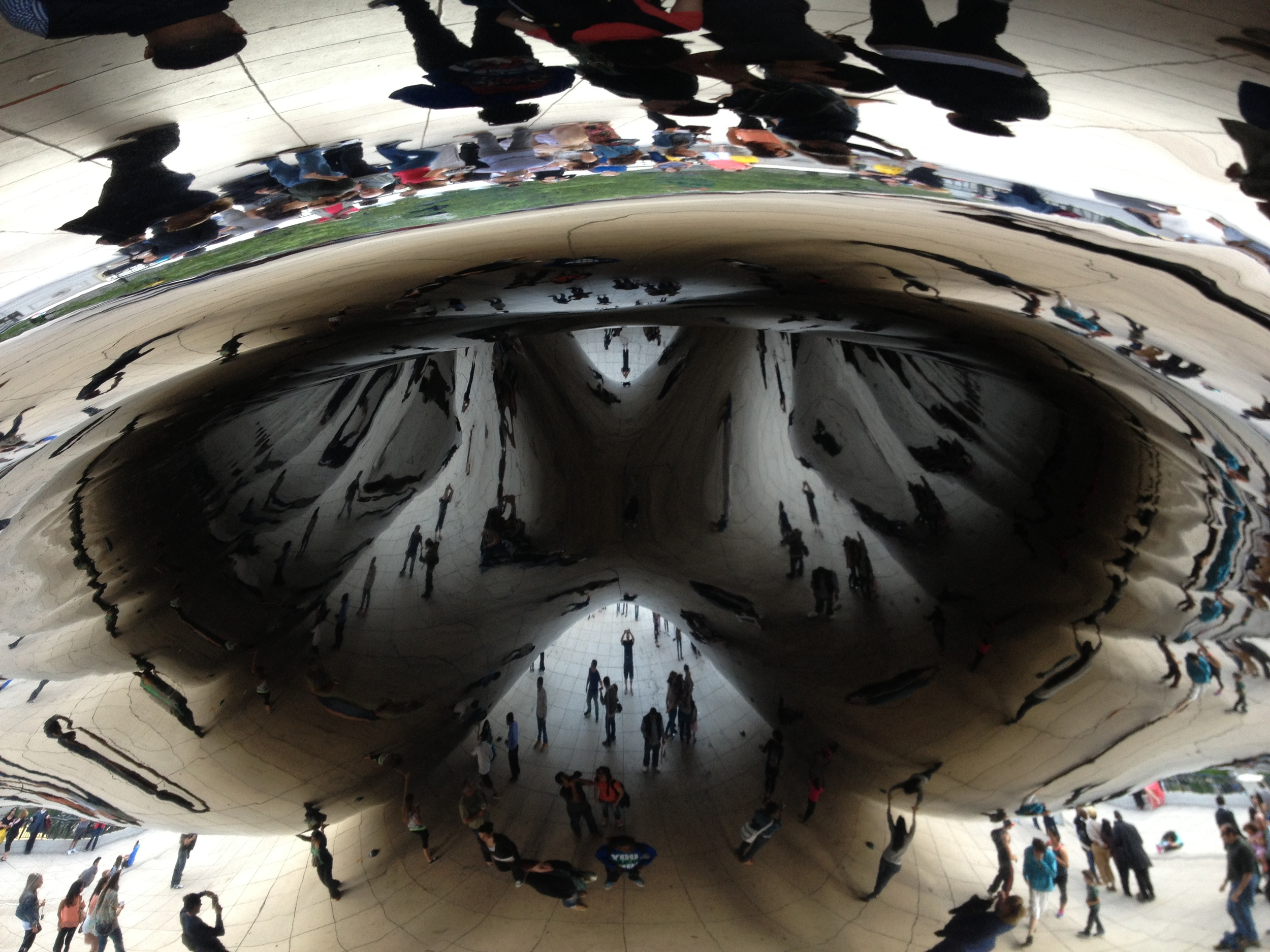 Cloud Gate aka The Bean is by Anish Kapoor and was installed in Chicago's Millennium Park in 2006. This giant bean-shaped polished stainless steel sculpture attracts thousands of visitors everyday, who love to look at and manipulate their reflections in the concave and convex mirror surface.  Everyone is smiling and laughing; people of all ages and from around the world are sharing the space in and around this work of art.  The public is engaged, which is what good public art should do.