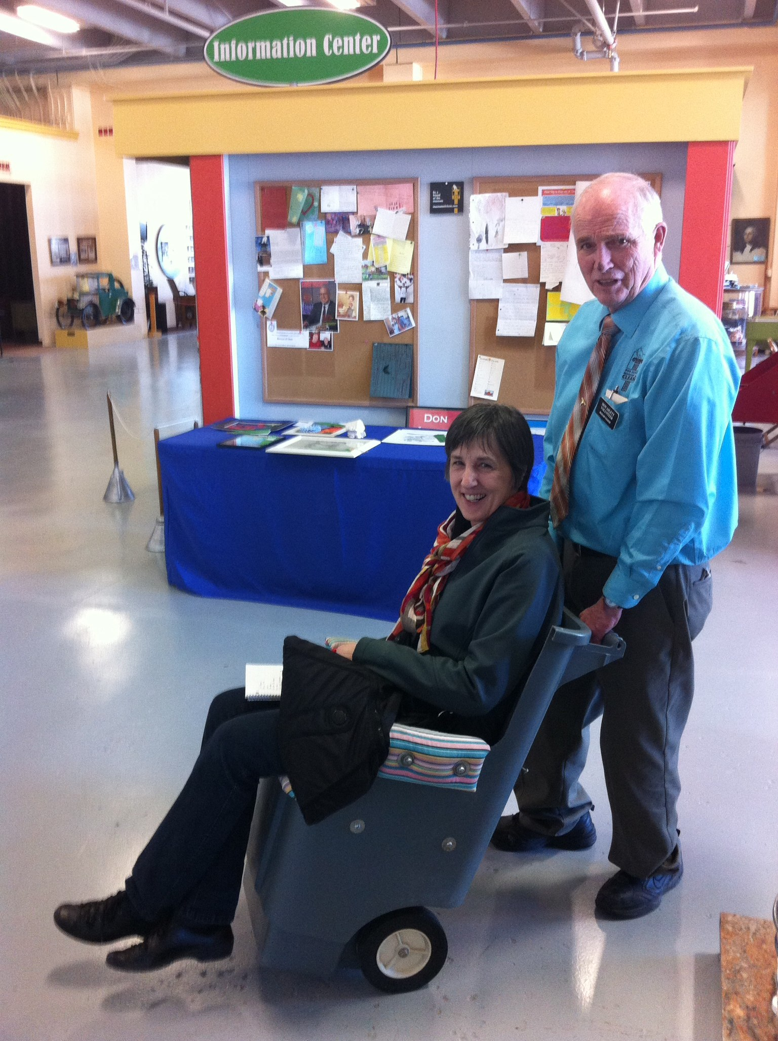 Don pushing Brenda in his wheel-chair garbage can. The museum is full of fun and kitsch.