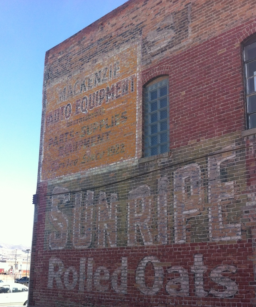 One of the many faded advertising murals that were painted on the sides of buildings in the early 20th century.