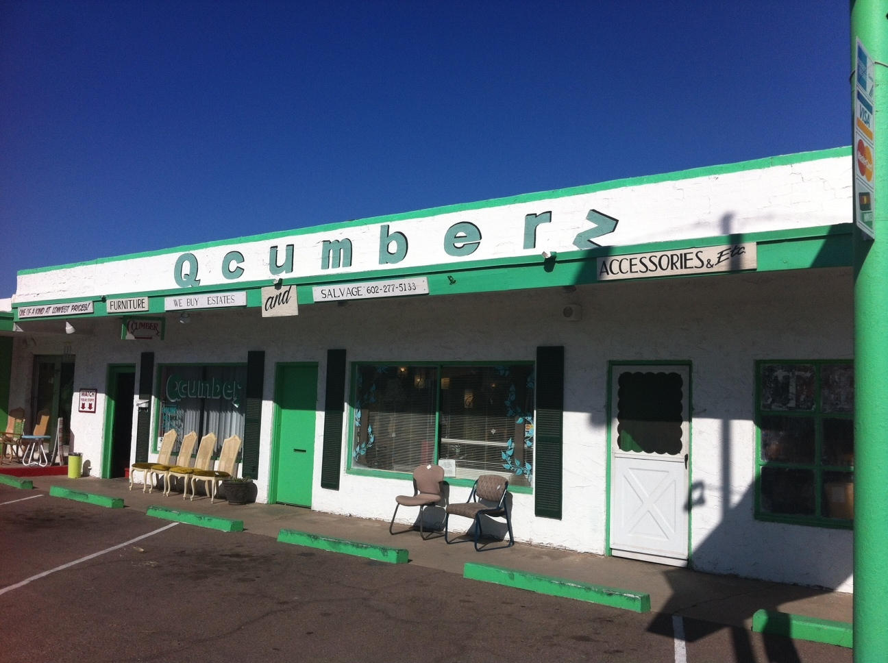 Qcumberz doesn't look like much from the outside, but get inside and you find it is jam-packed with vintage and kitchy artifacts.