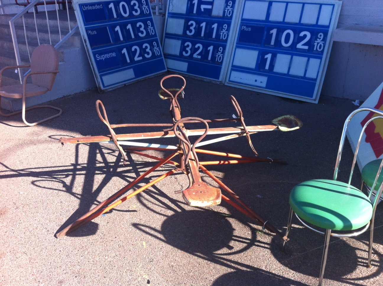 Found this old teeter totter in front of Zinnias.
