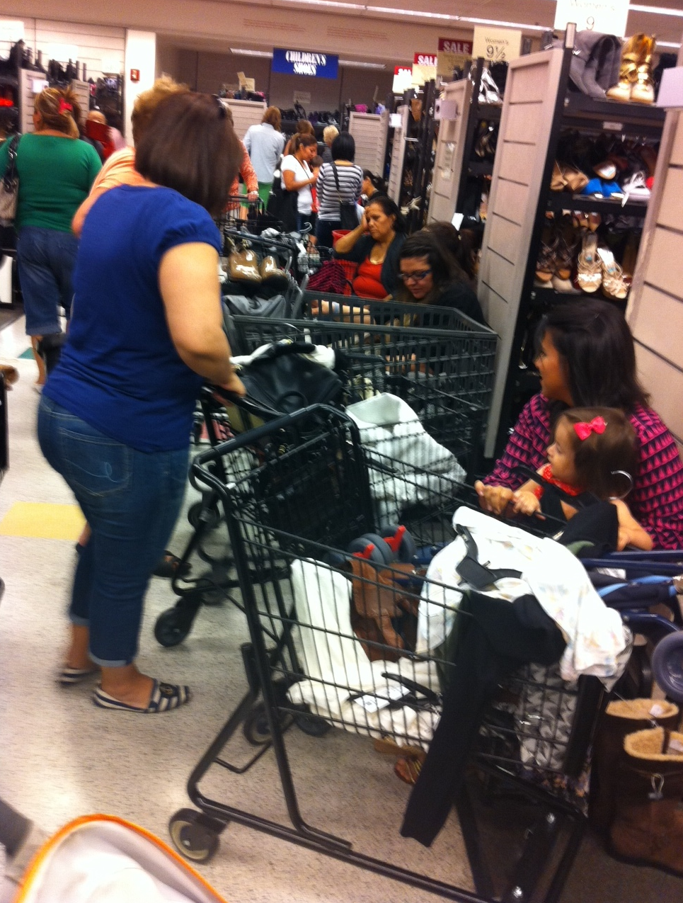 It is gridlock in the store as everyone has a cart and the aisles are narrow.