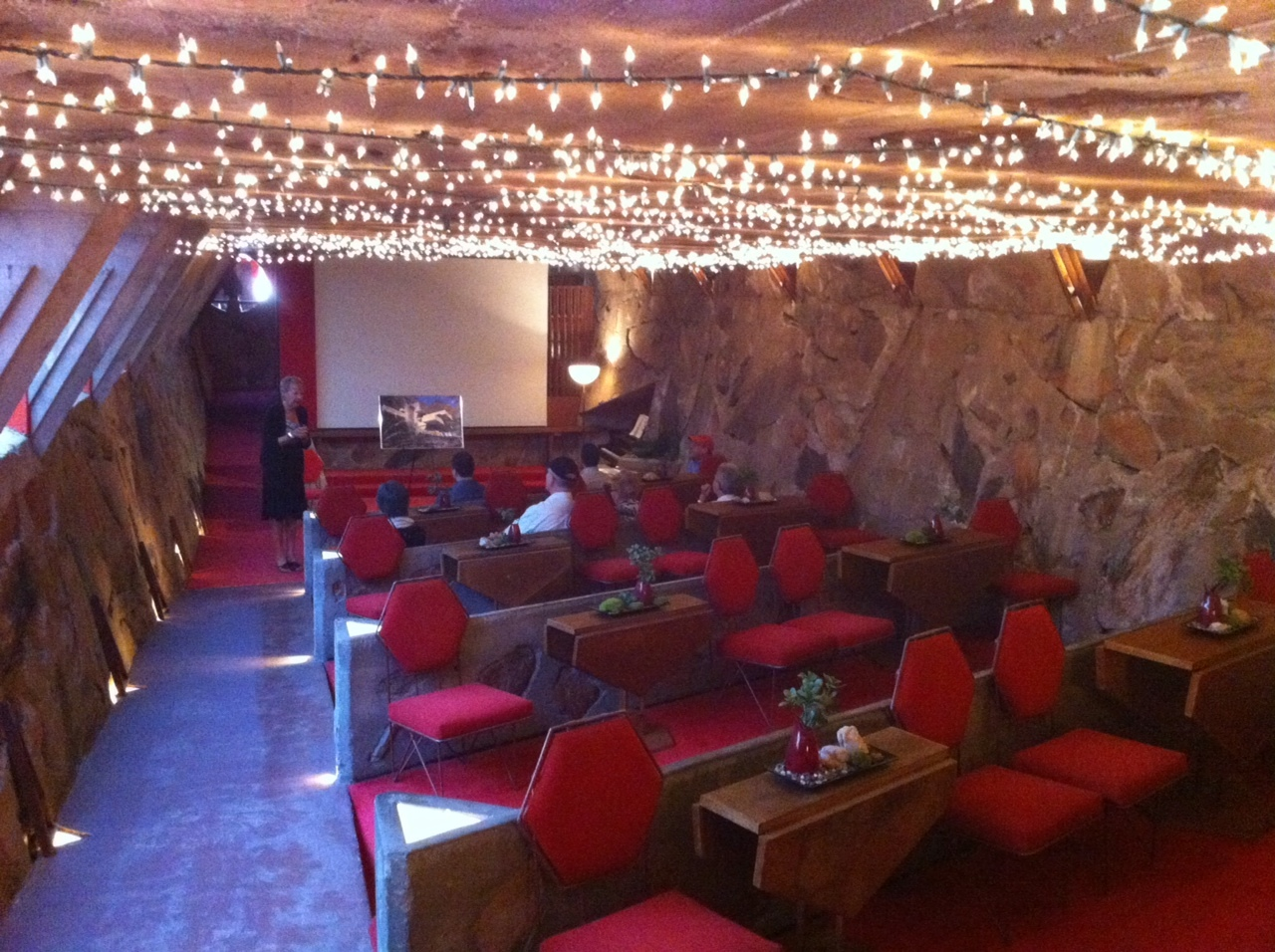 The Cabaret room was designed to allow for flexible seating, near perfect sight lines and great acoustics. Wright owned nine pianos and if hadn't become an architect he would have chosen to be a concert pianist. The ceiling twinkle lights were added after his death by his wife who thought they reminded her the night stars in the desert.