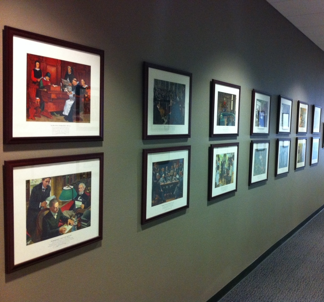 "This is one of two walls lined with the ""Great Moments in Pharmacy"" lithographs."
