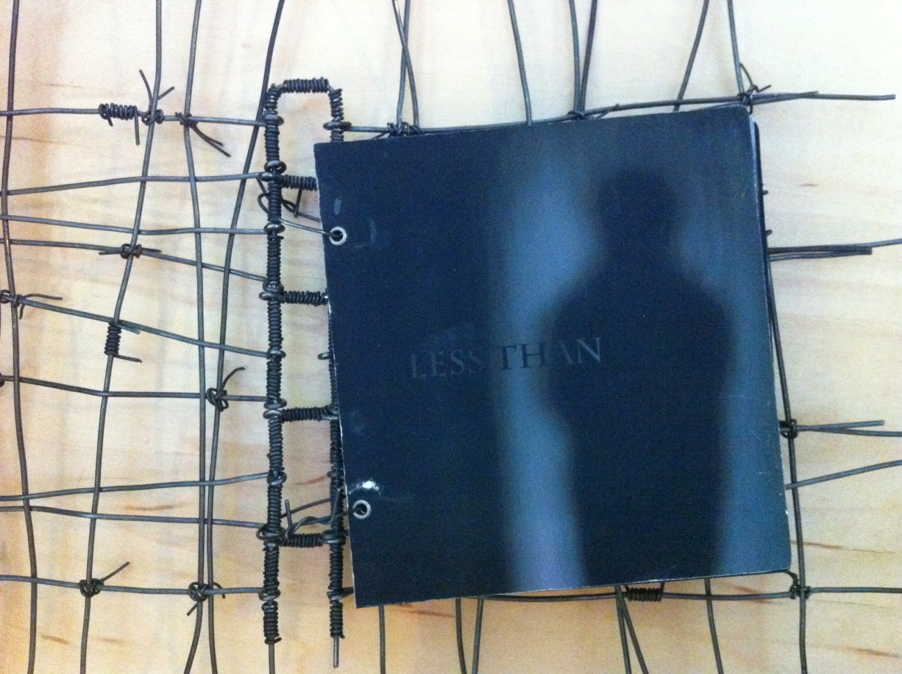 """Less Than"" art book cover"