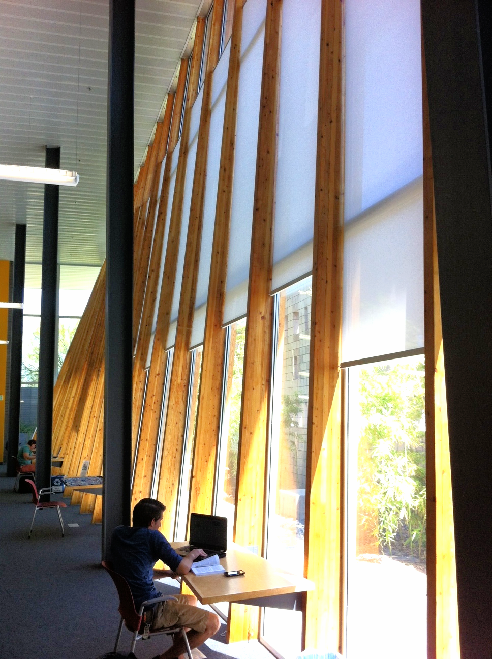 The Poetry Center's indoor/outdoor working spaces are separated by an intriguing two-story slanted wood and glass wall.