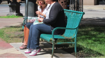 Downtown seating is often too high for people to sit comfortably with their feet on the ground.