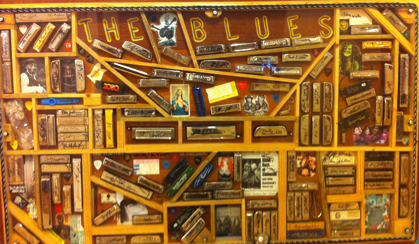 A framed collection of harmonicas.