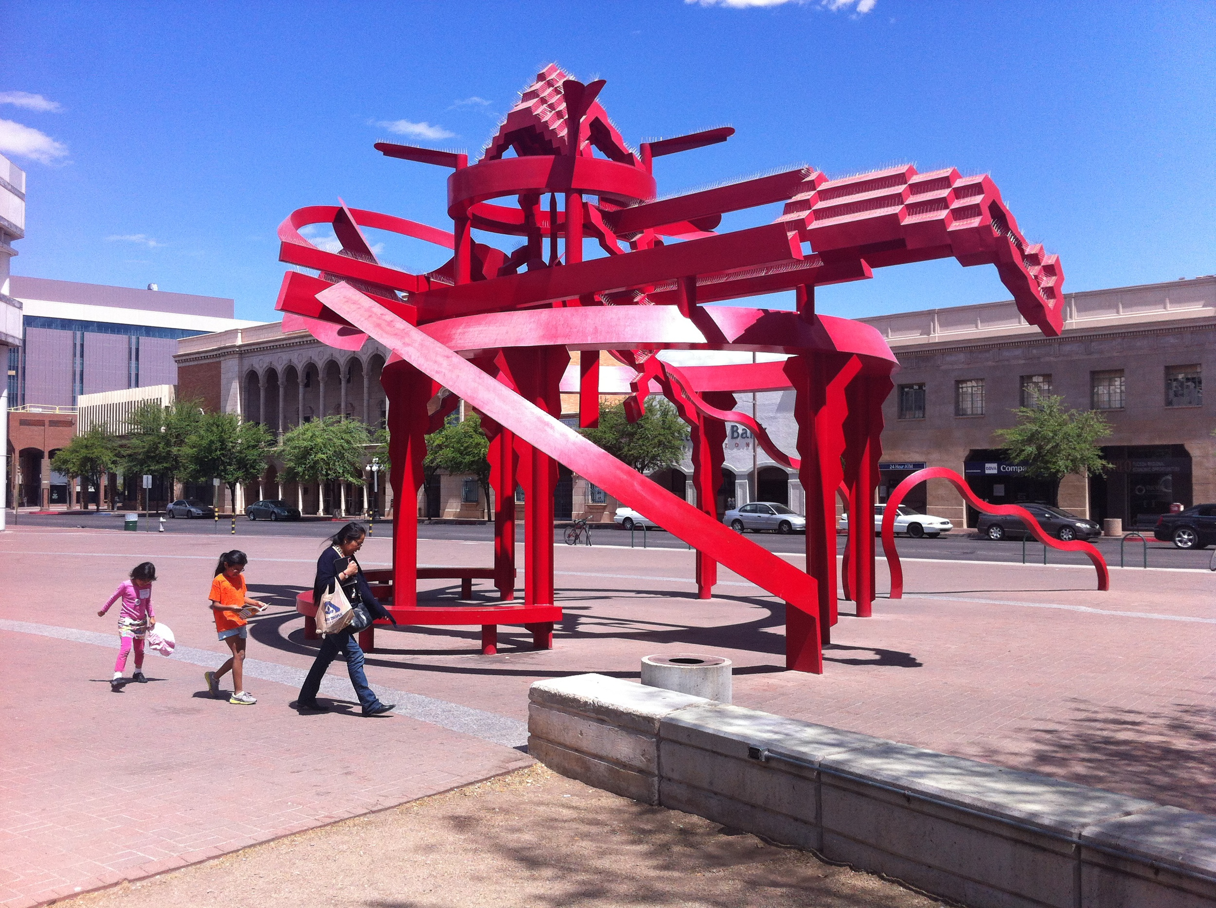 This piece sits outside the Tucson Public Library in their Cultural District.  I couldn't find information on the artist or the title.  We passed this piece several times and never saw anyone stopping to look at it.