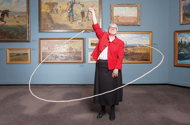 Donna Livingstone showing off her lassoing abilities.  A new kind of art museum, needs a new kind of President & CEO! (Photo credit: Calgary Herald)