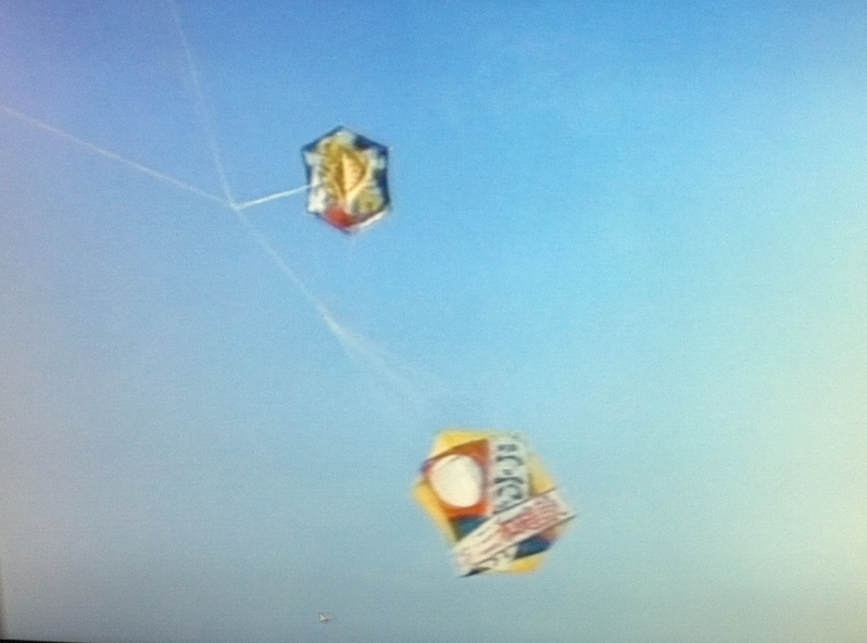 Still image from video that of kite fighting.