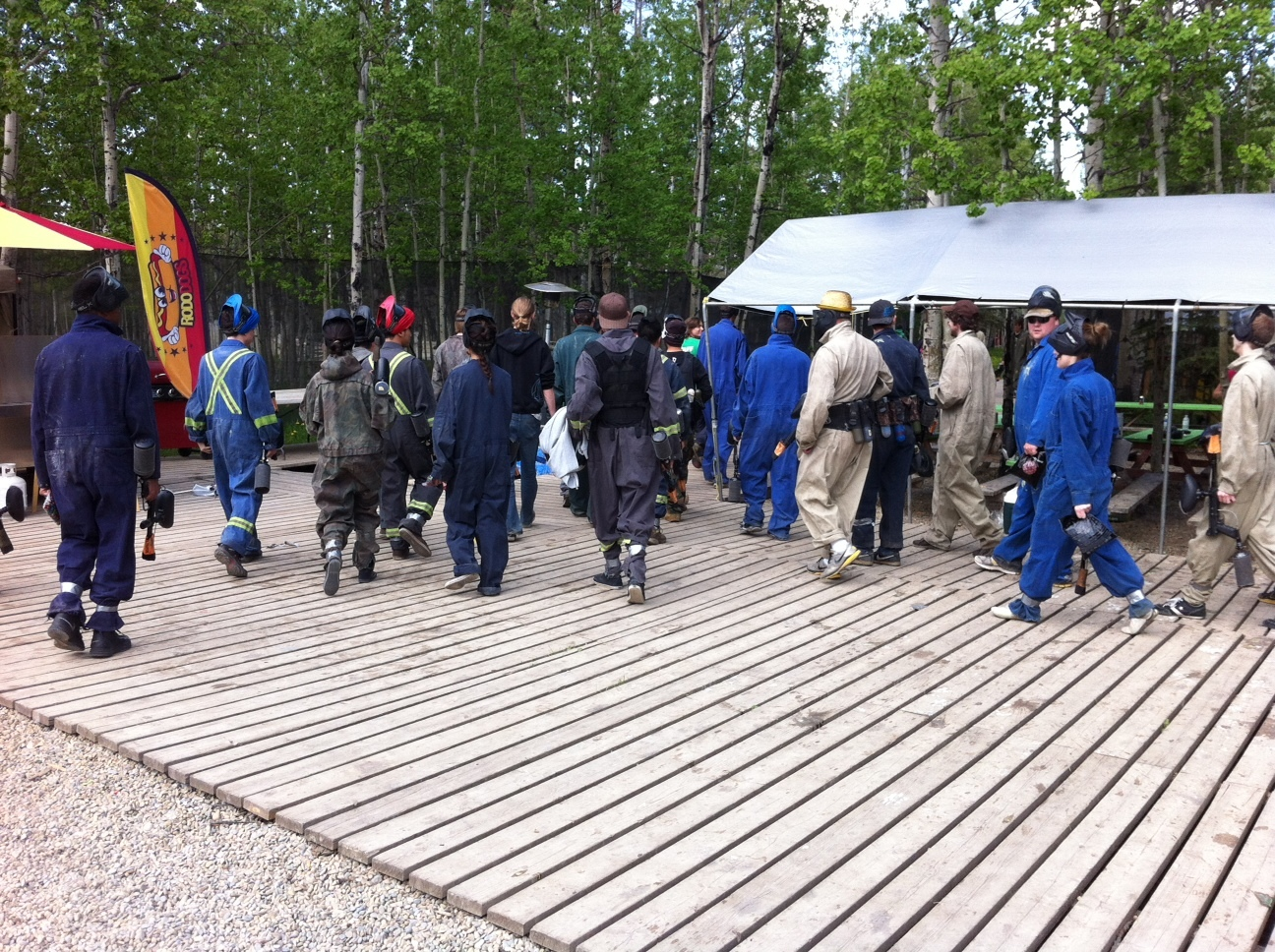 A large group of players head out to one of the many different themed fields at Bragg Creek Paintball.