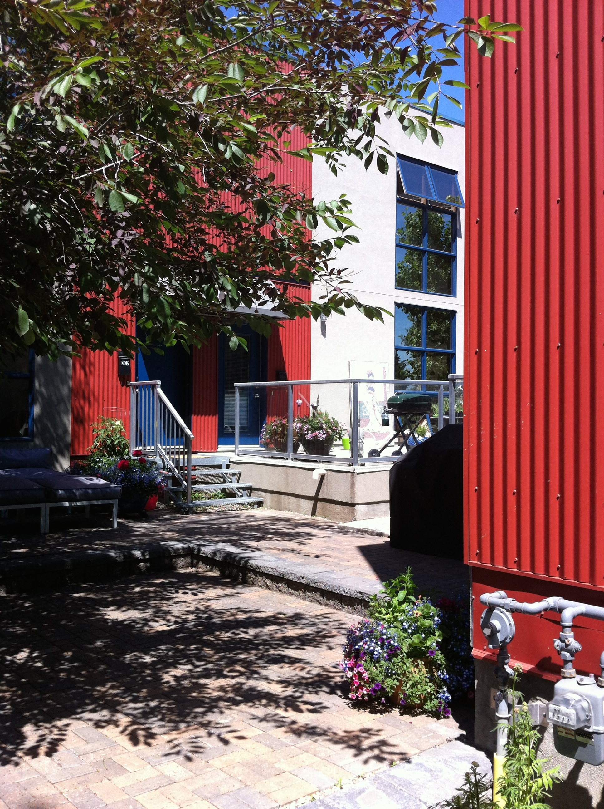 Just a stone's throw from the CPR rail lines, the backyard patios are like a hidden urban oasis.